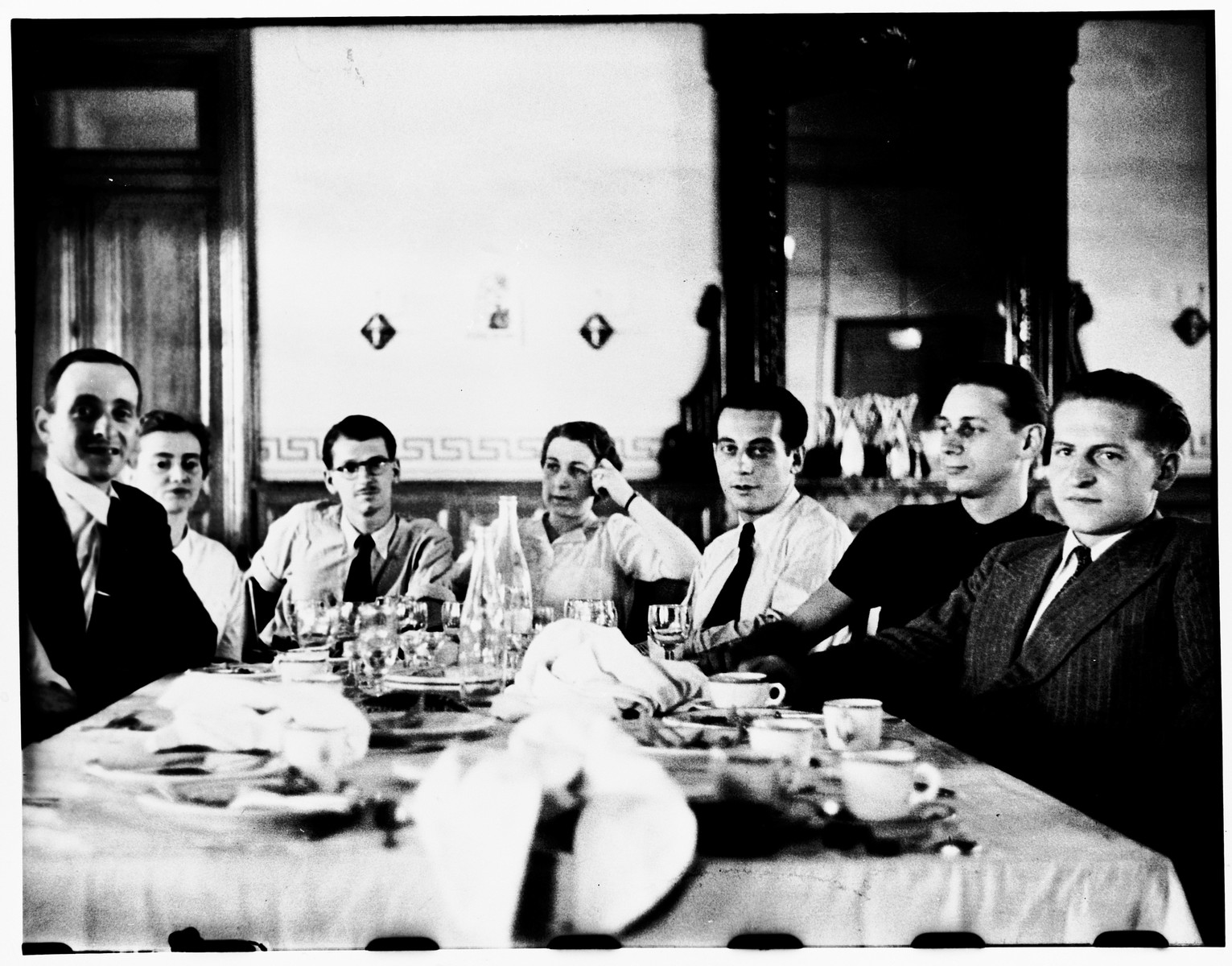 Members of the Centre Americain de Secours attend a farewell dinner at the Cerbere train station.  Seated from left to right are Jacques Weisslitz, Theodora Ungemacht Benedite, Daniel Benedite, Lucie Heymann, Louis Coppermann, Marcel Verzeanu, and Jean Gemahling.