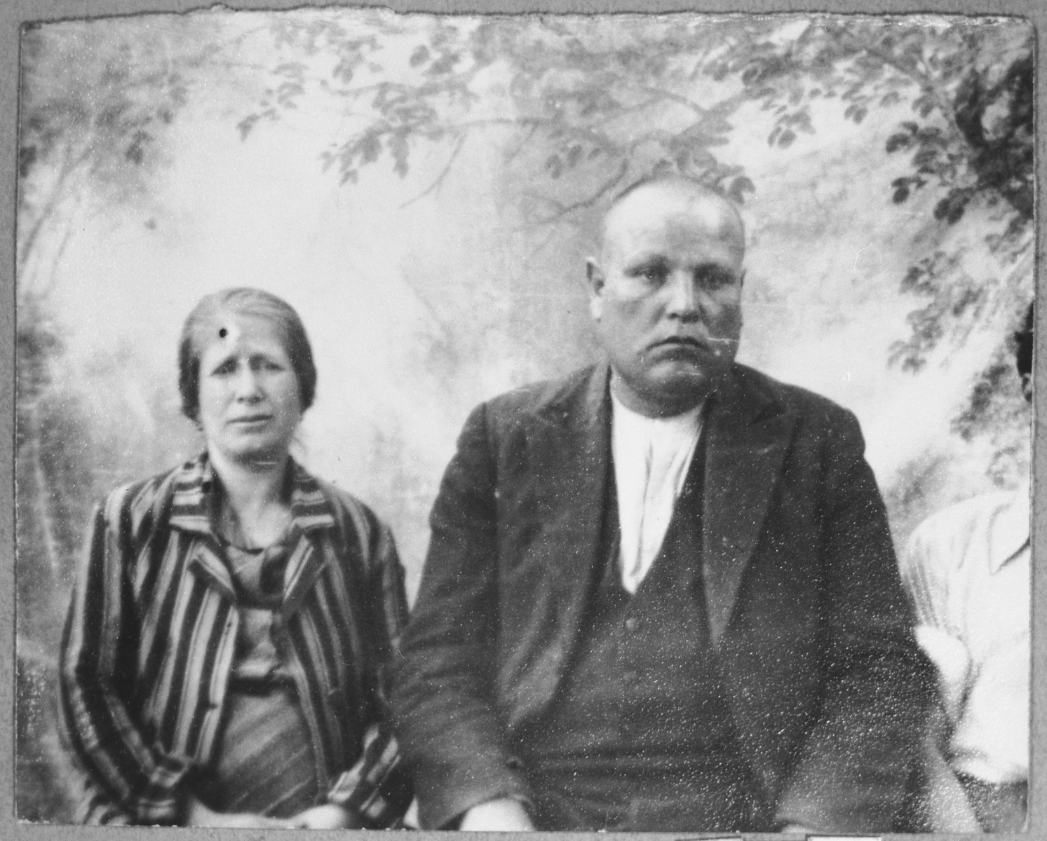Portrait of Todoros Levi, son of Mair Levi, and Todoros' wife, Rekula.  Todoros was a rag dealer.  They lived at Zmayeva 5 in Bitola.