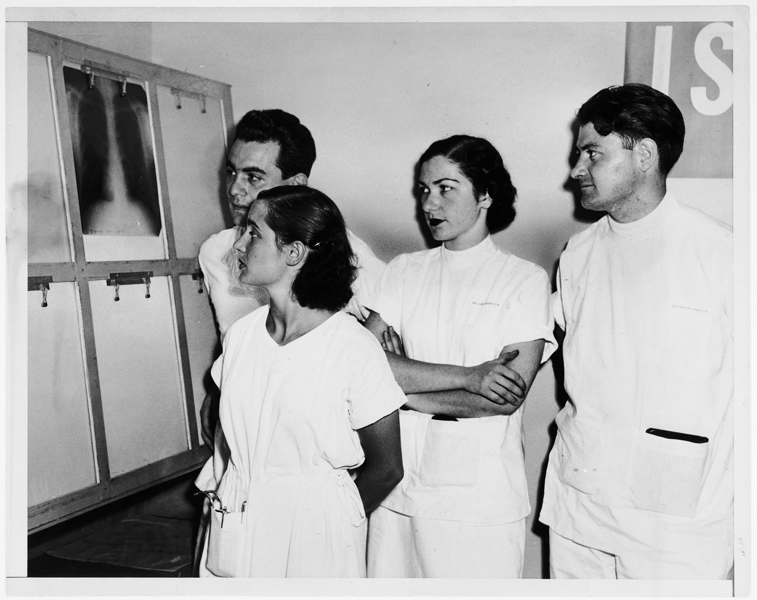 Four Jewish medical students study a lung x-ray.  From left to right are Paul Ornstein, his wife Anna Brunn Ornstein, Luisa Schwarzwald and Stephen Hornstein.