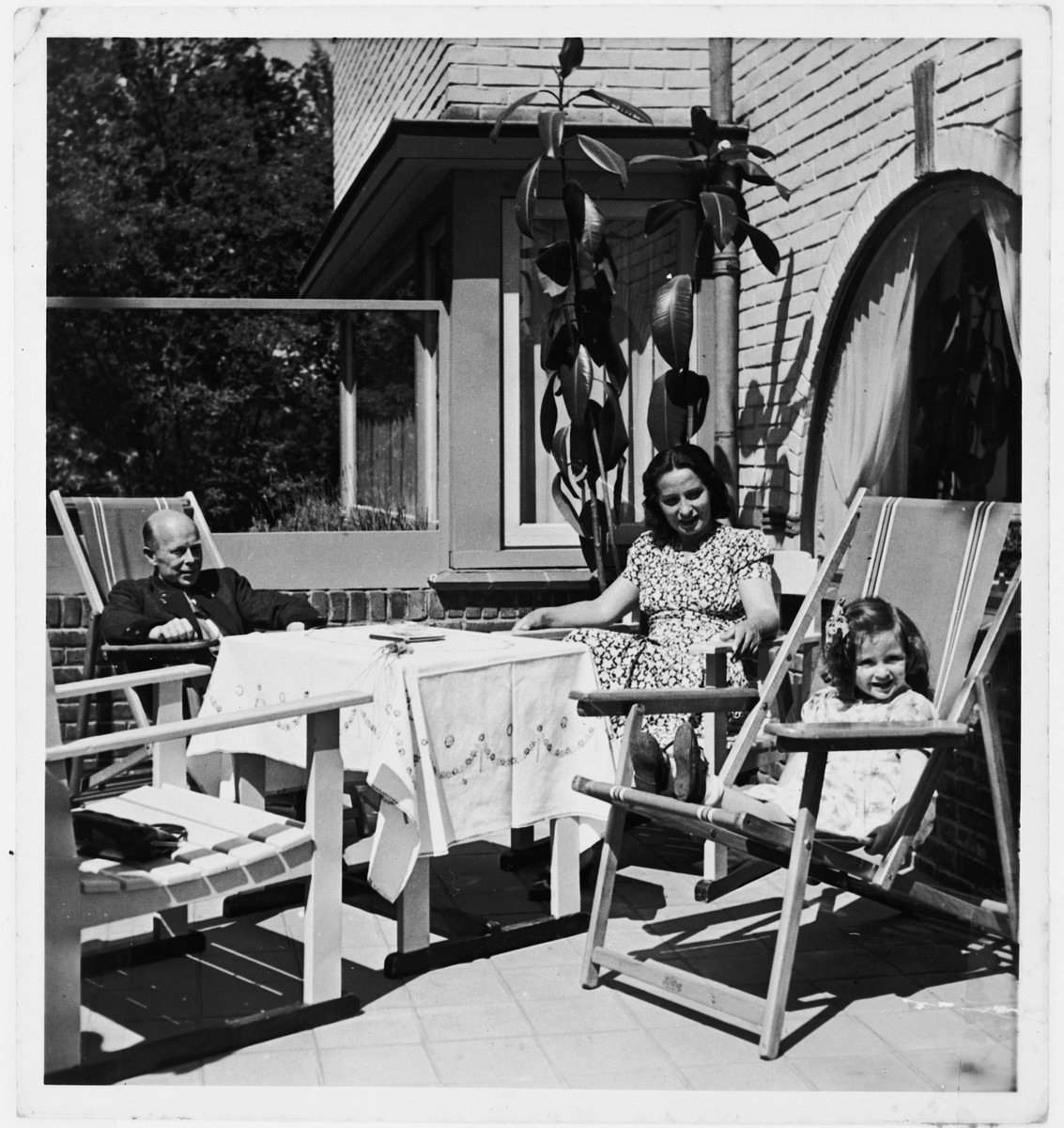 Julia Ensel sits on the terrace of her home with her mother Rosmarie Schink and stepfather, Dr. Herbert Mauthner.