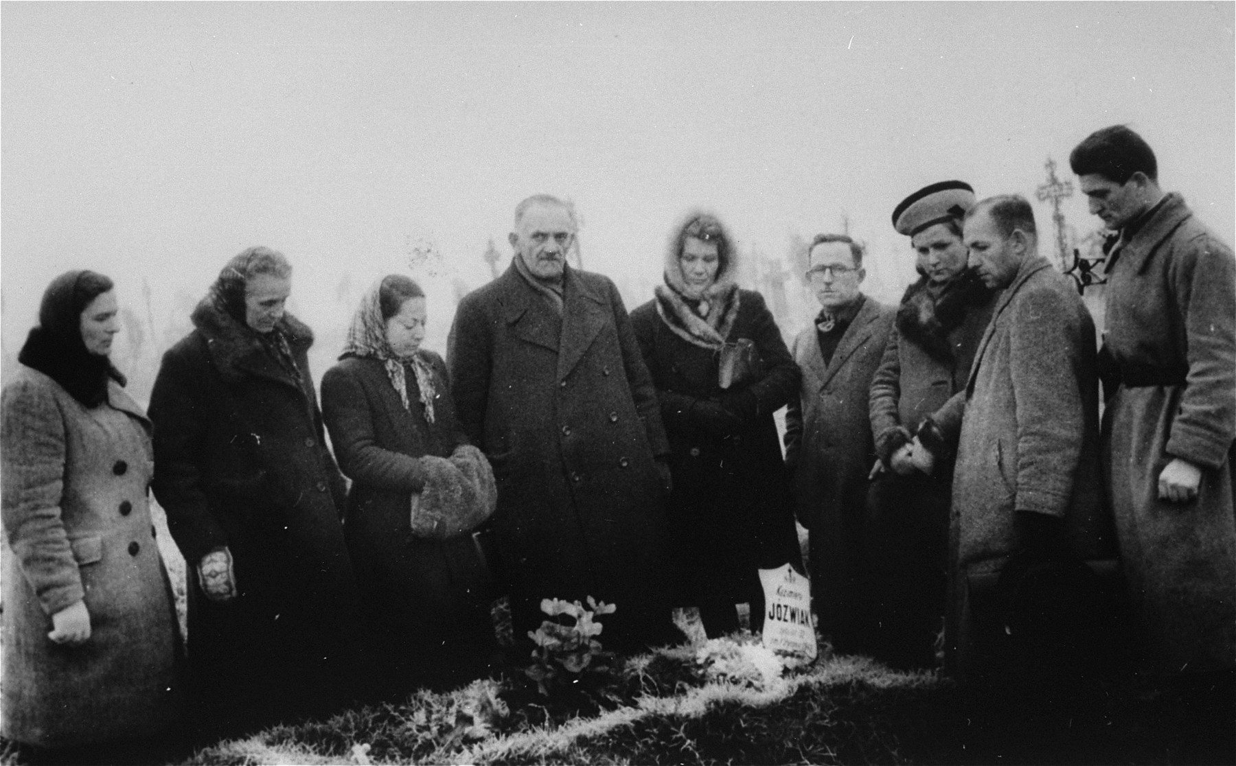 Funeral of Warsaw ghetto resister Gina (Regina) Klepfisz, in the Brodno Catholic cemetery.  Most of the people in attendance are Jews in hiding or Poles who are helping them.  Pictured from left to right are: Edzia Korman (Jewish); Anna Wachalska (a Polish woman who sheltered Michal Klepfisz and other Jewish resisters); Rozka Perczykof Klepfisz (Michal's wife); unidentified; Maria Sawicka (Anna Wachalska's sister, who also sheltered Jews);? Zuknadel; Krysia Tylberg; ? Czyzyk;  and Jasio Starker.