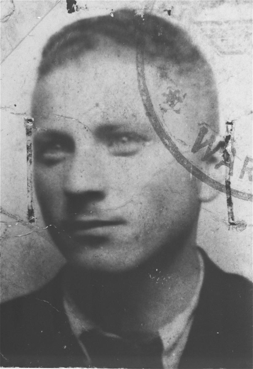 False identification card photo of Benjamin Miedzyrzecki, a member of the Warsaw ghetto underground.