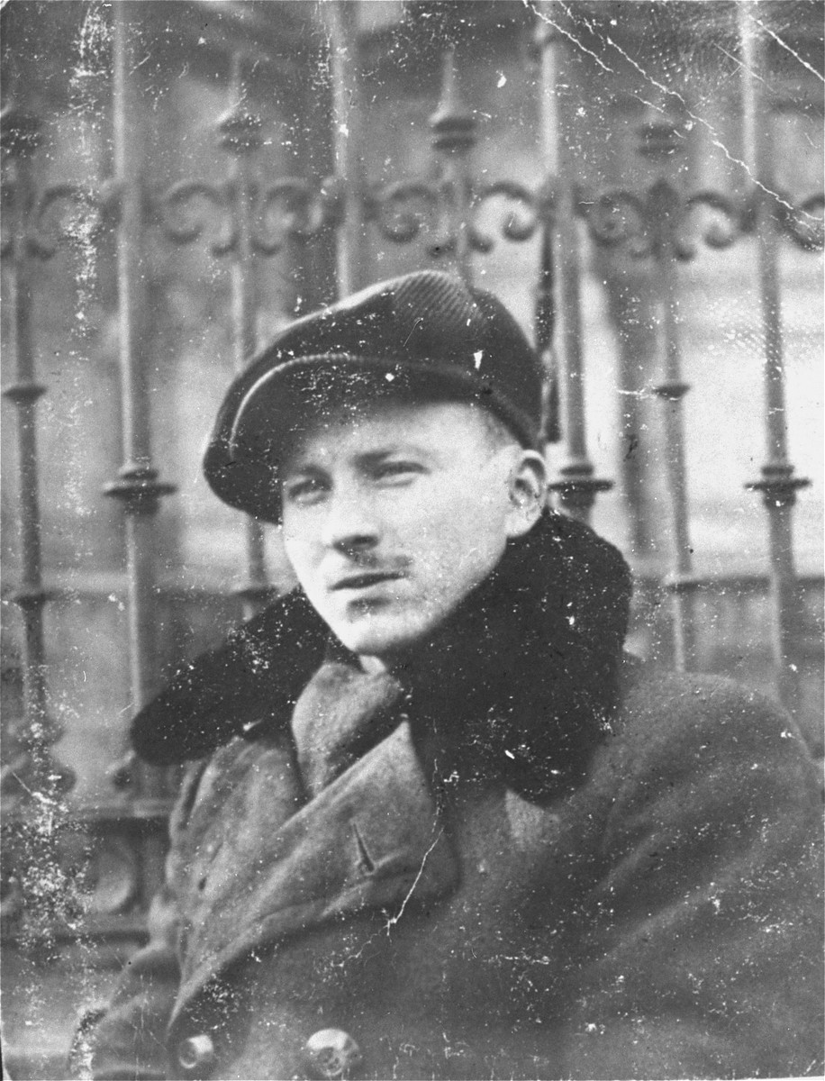 Benjamin Miedzyrzecki, a member of the Jewish underground living in hiding on false papers, poses in Ogrod Saski (Saski Gardens) on the Aryan side of Warsaw.
