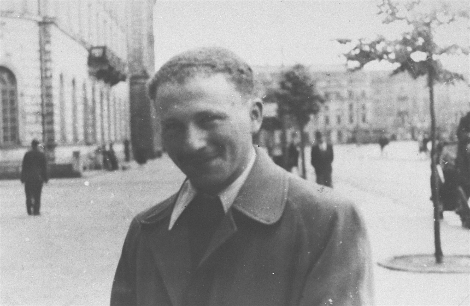 Benjamin Miedzyrzecki, a member of the Jewish underground living in hiding on false papers, poses in Plac Teatralny (Theater Square) on the Aryan side of Warsaw.