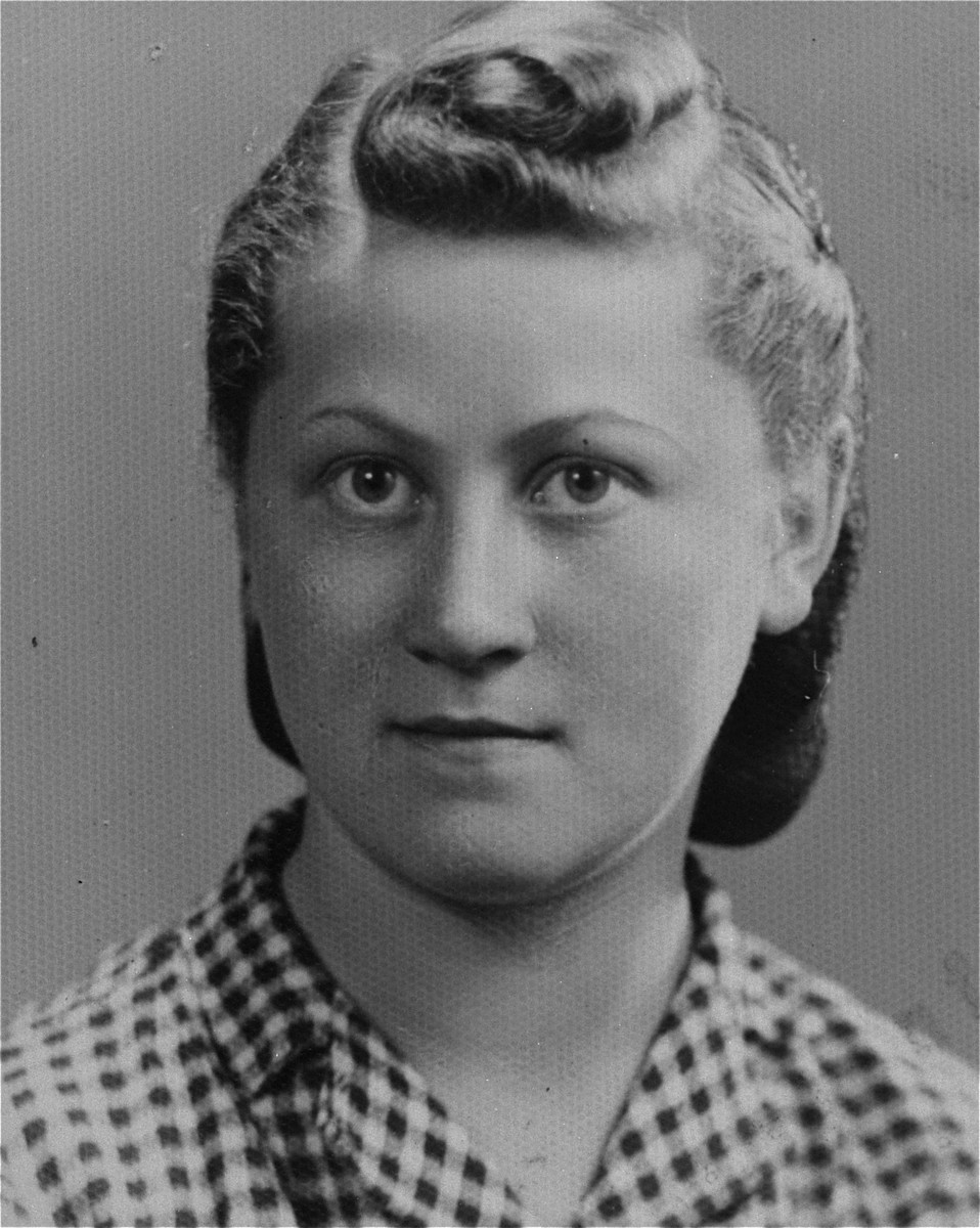 "Portrait of Ester Fiks (Julcia), a member of the Hashomer Hatzair Zionist youth movement, who lived on false papers and served as a courier in the Jewish underground.    The Polish inscription on the back of the photograph reads, ""During our underground life/ From our times of misfortune/ To my dearest friend/ Jula 1944"".  Julcia met Lodzia Hamersztajn in 1943 while they were both living on false papers in Krakow and working for the Germans.  They stayed together until the liberation.  Julcia had a younger brother, Benzion, known as Bolus, who survived the war on the Aryan side of Warsaw as one of the cigarette sellers in Three Crosses Square.  Julcia and her brother immigrated to Palestine in 1946."
