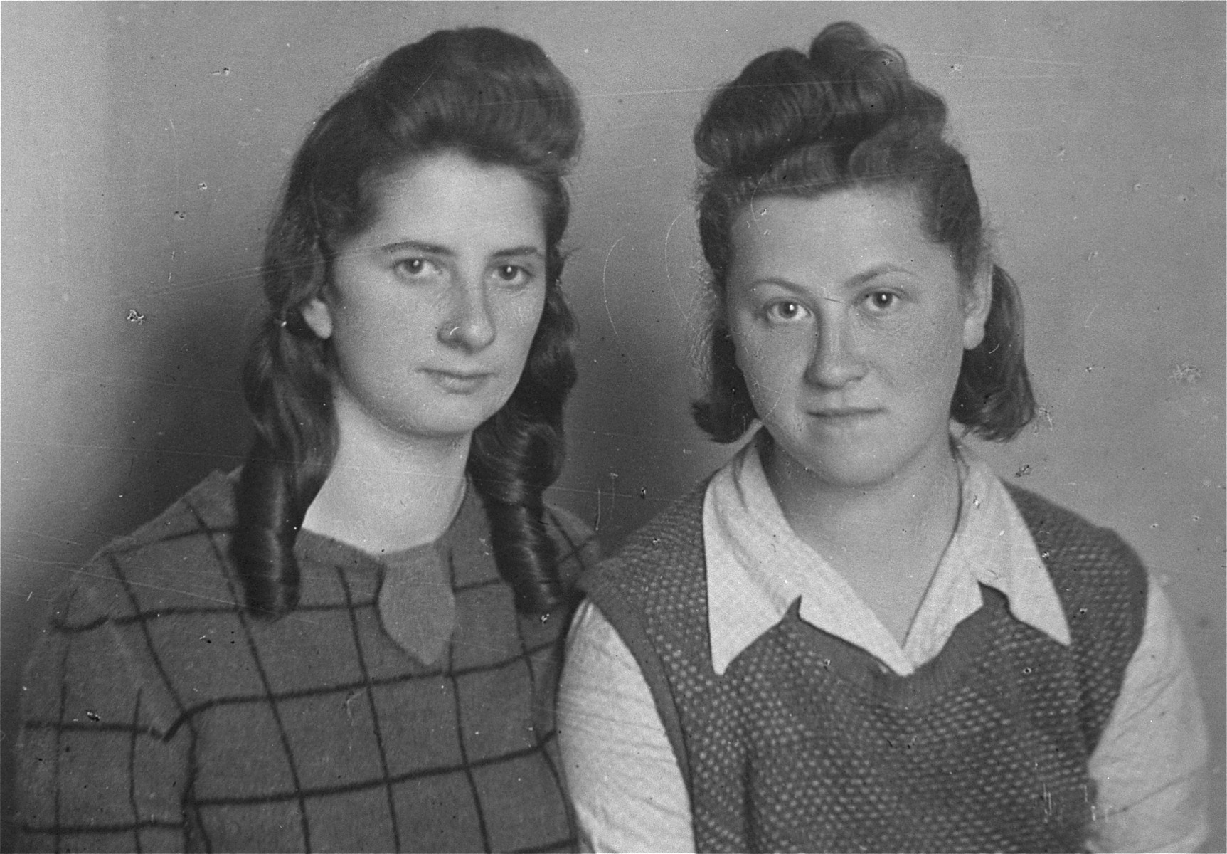 Portrait of Lodzia Hamersztajn and Ester Fiks (Julcia) after the liberation.  Both were members of the Hashomer Hatzair Zionist youth movement and couriers in the Jewish underground in Poland.   Julcia met Lodzia Hamersztajn in 1943 while they were both living on false papers in Krakow and working for the Germans.  They stayed together until the liberation.  Julcia had a younger brother, Benzion, known as Bolus, who survived the war on the Aryan side of Warsaw as one of the cigarette sellers in Three Crosses Square.  Julcia and her brother immigrated to Palestine in 1946.