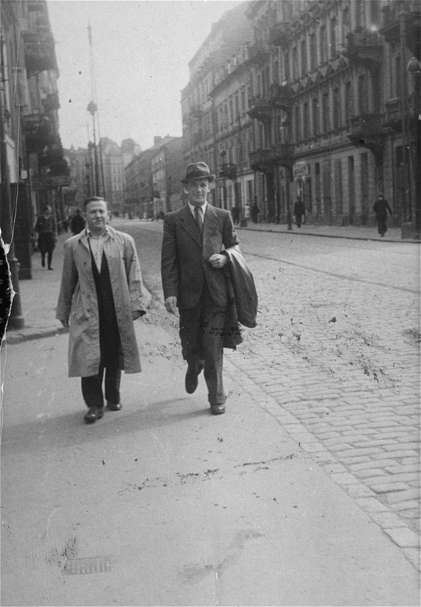 Stefan Grajek (right) leads Tuwia Borzykowski through the streets of Aryan Warsaw to a new hiding place.