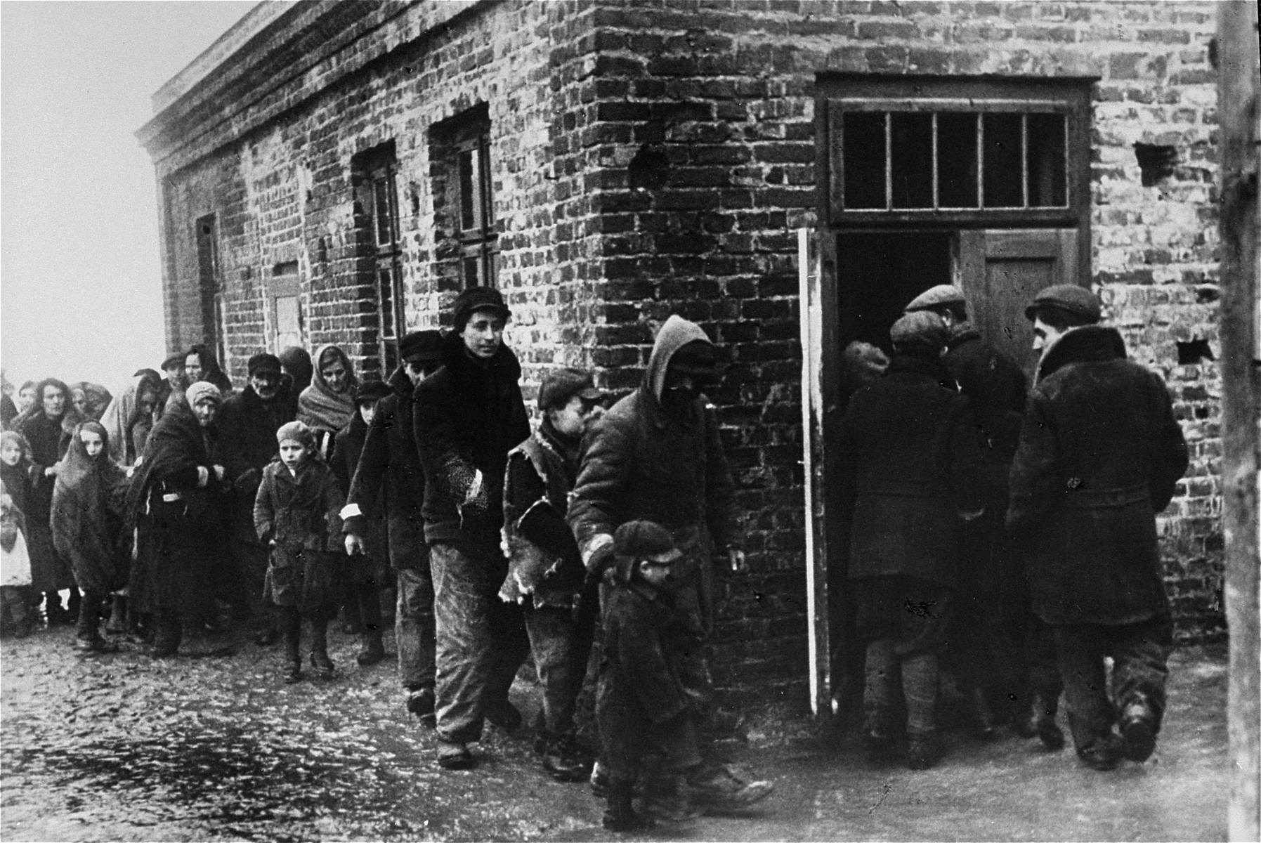 Jews in the Warsaw ghetto awaiting their turn in the soup kitchen.