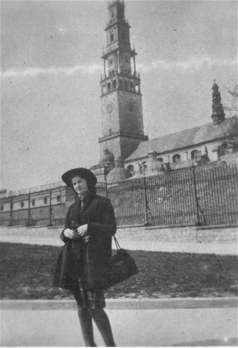Lodzia Hamersztajn, a Jewish woman living on false papers, poses in front of the Jasna Gora monastery in Czestochowa.