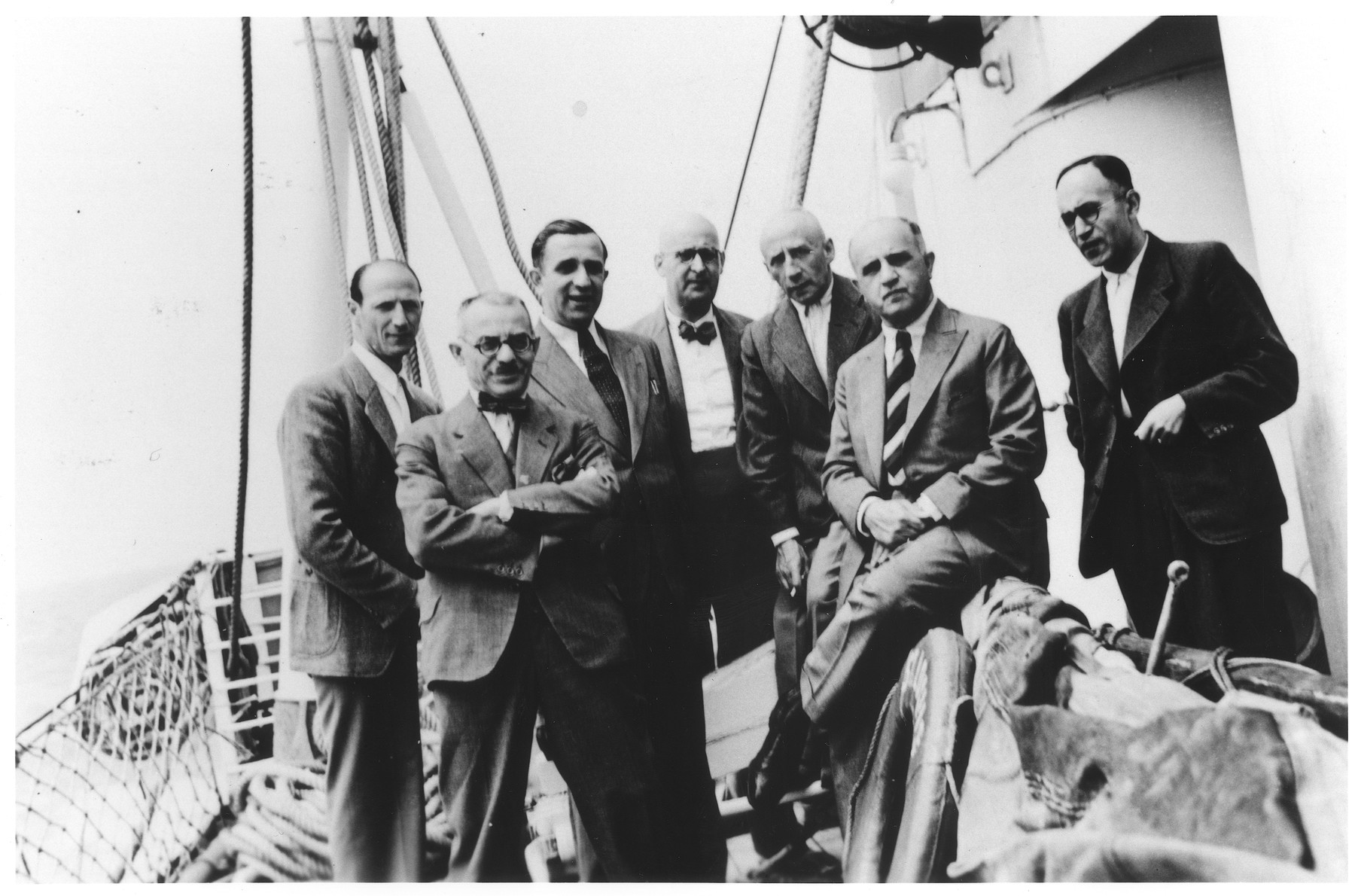 Members of the passenger committee of the MS St. Louis pose on the deck of the ship.  Pictured from left to right are: Guttman, Max Weiss. Herbert Manasse, Max Zellner, Josef Joseph, Arthur Hausdorff and Ernst Vendig.