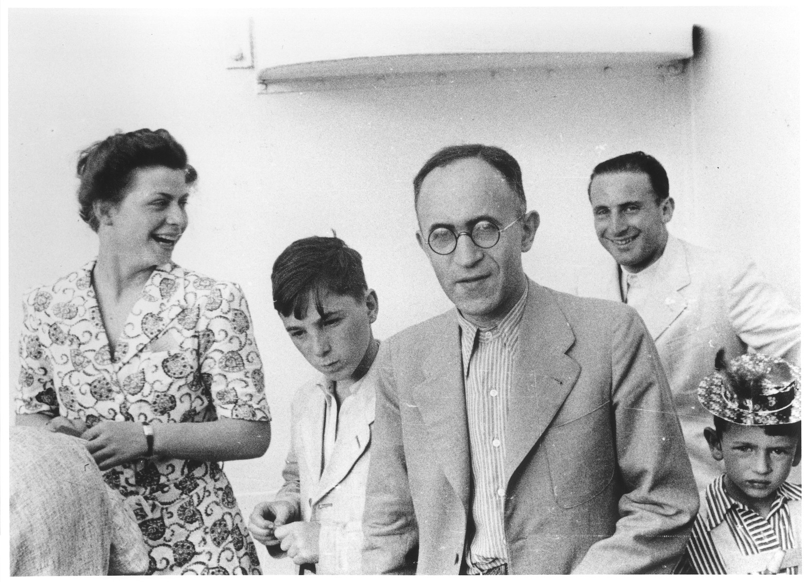 Passengers on the deck of the MS St. Louis.    Pictured in the foreground is Ernst Vendig, a member of the passenger committee.