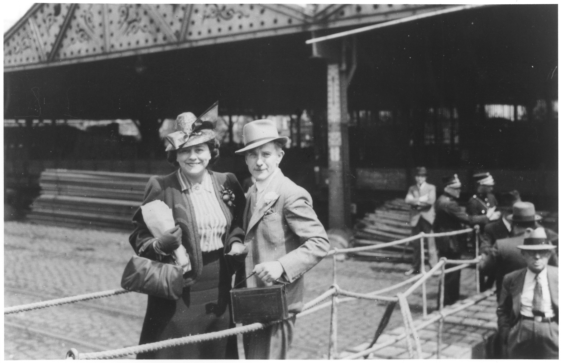 A Jewish refugee couple poses on the gangway of the MS St. Louis as they disembark from the ship in Antwerp.