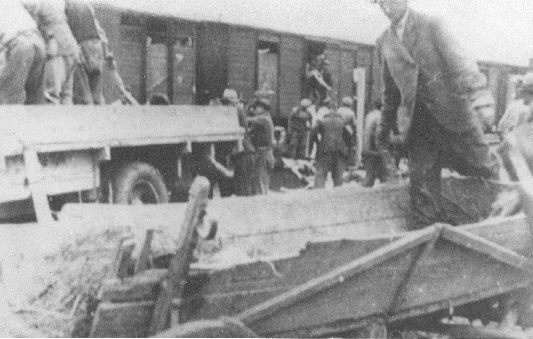Gypsies remove bodies from the Iasi-Calarasi death train during its stop in Targu-Frumos.