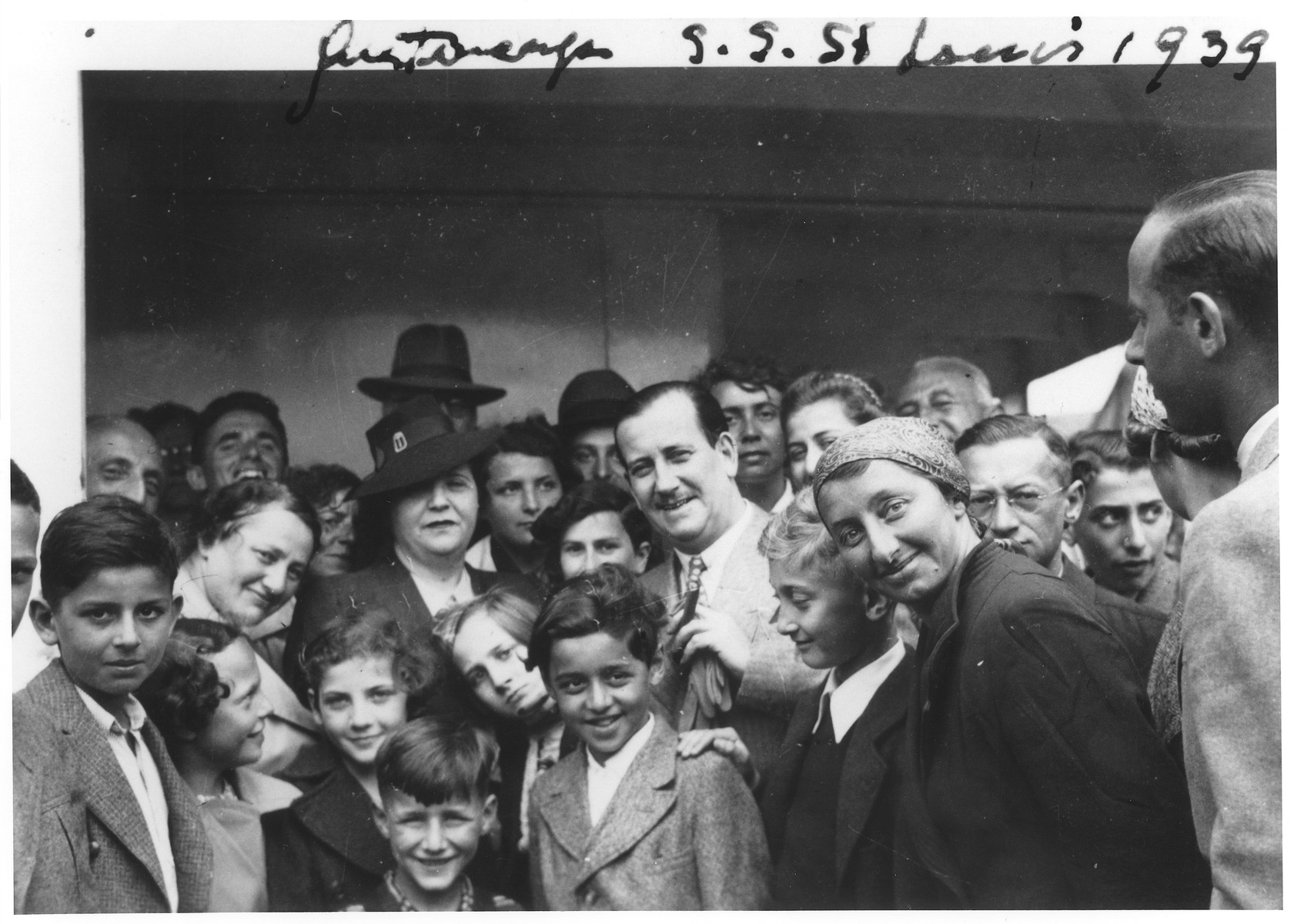 Mr. and Mrs. Morris Troper (center) pose with Jewish refugees on the deck of the MS St. Louis in the port of Antwerp.    Also pictured are Liesel Joseph, Ruth Karliner, Heinz Gallant and Windmueller.