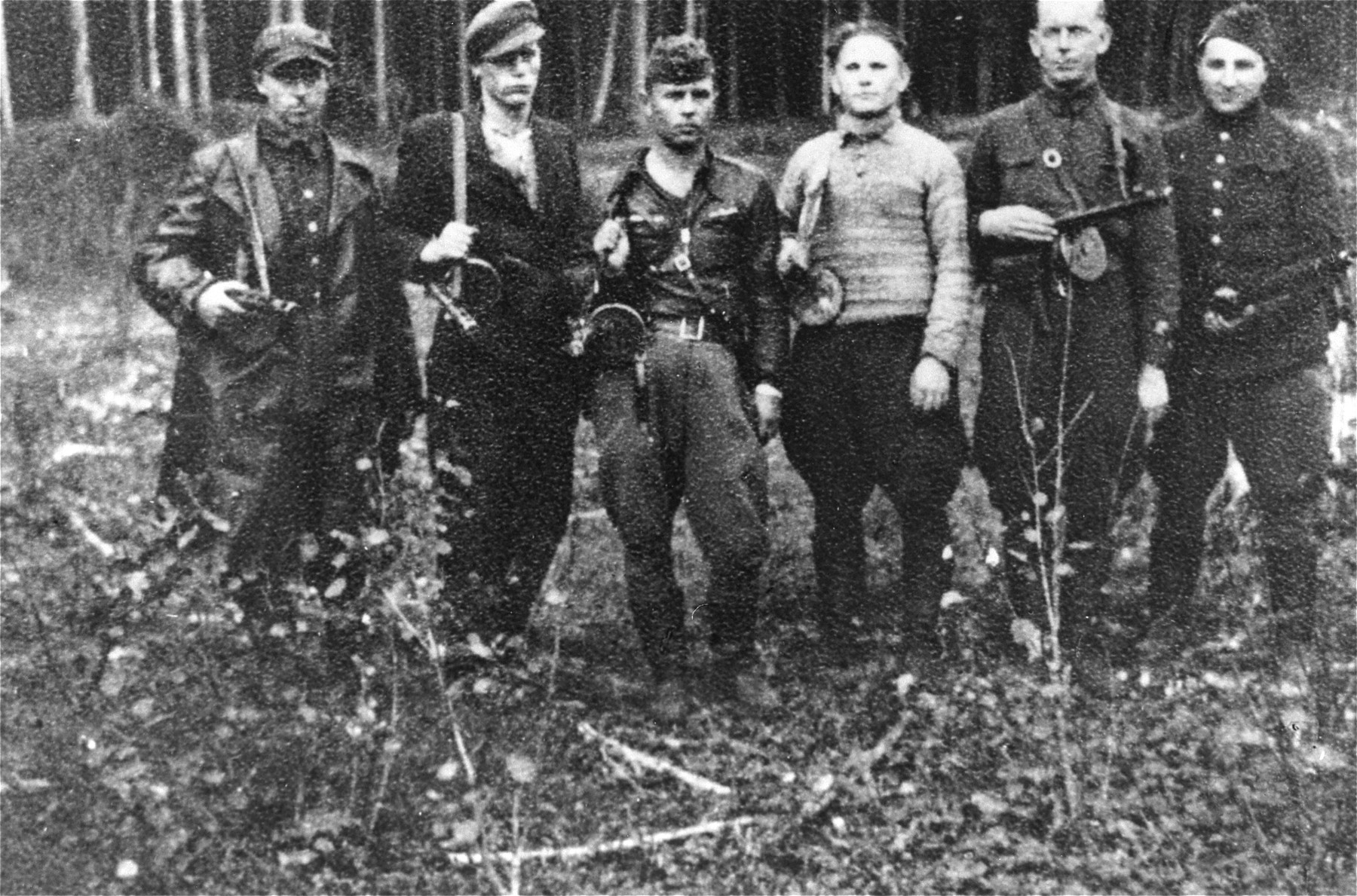 A Jewish partisan group in the Rudninkai forest.    On the far right is Max (Motl) Wischkin.  Moshe Abramovytz (b. 1917 in Kosvo Polska) is fourth from the right.