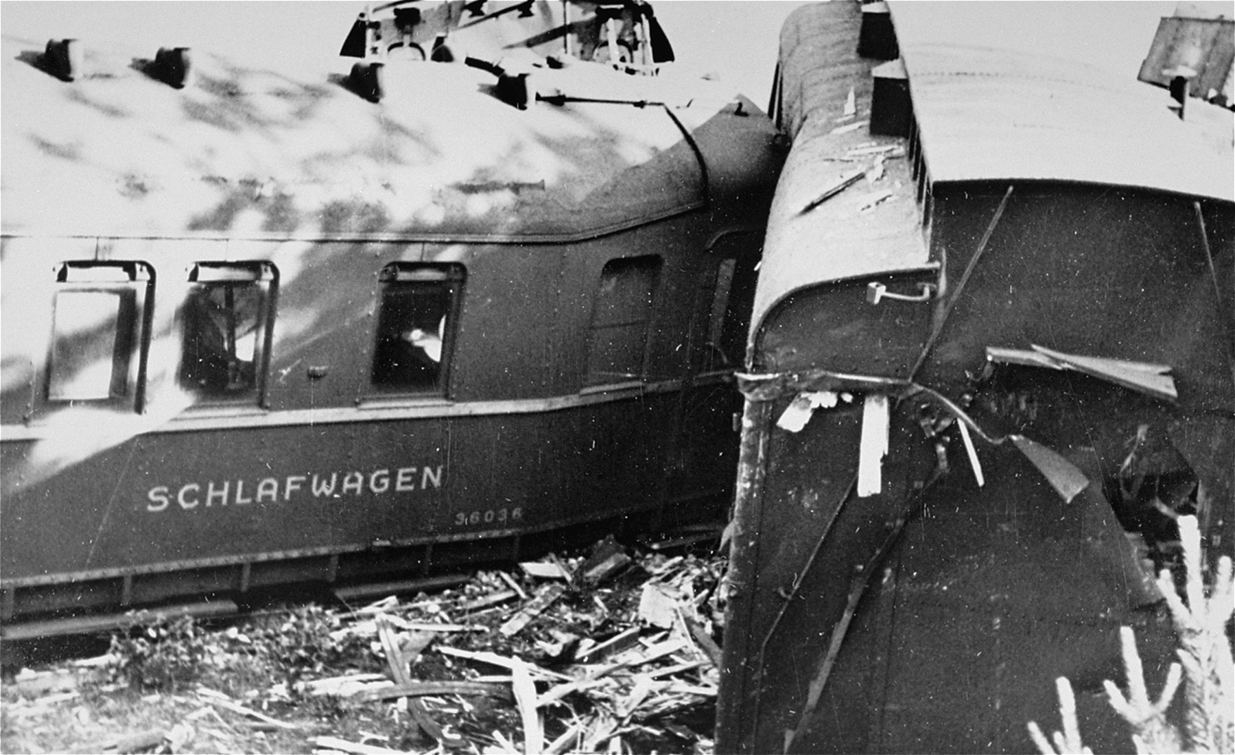 The sleeping car of a German train lies next to the tracks where it was derailed by the Polish resistance.