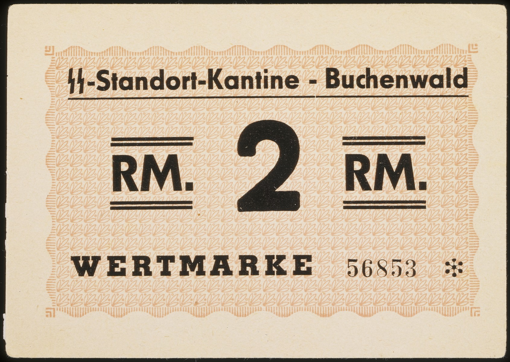 """2 Reichs Mark note from the Buchenwald concentration camp.  Printed on the front of the bill is: """"SS-Standort-Kantine-Buchenwald; RM 2 RM/ Wertmarke 56853 [SS Standort Cantine; 2 Reichs Marks; standard value, serial number 56853]."""
