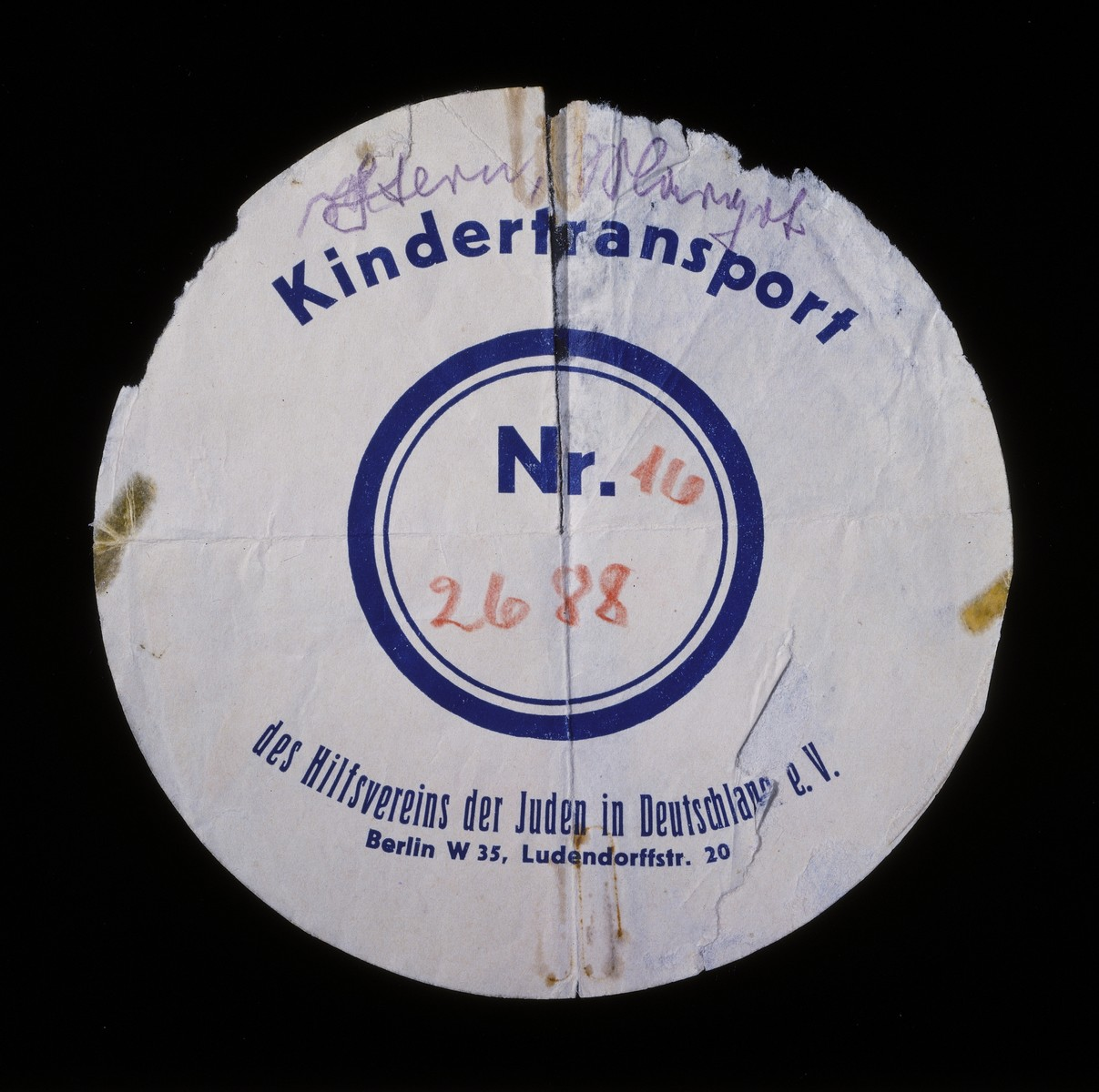 Circular label removed from the suitcase used by Margot Stern when she was sent on a Kindertransport to England.