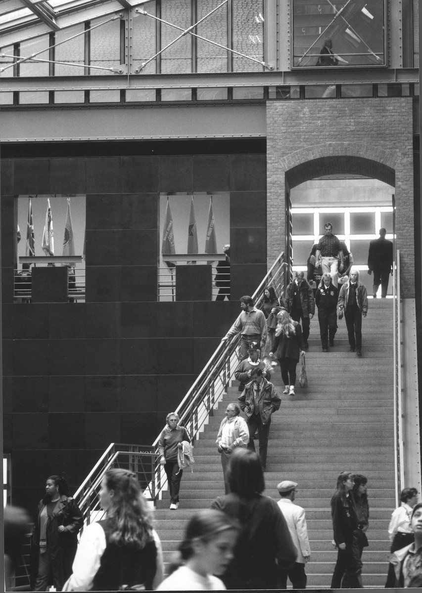 Visitors descending the staircase in the Hall of Witness at the U.S. Holocaust Memorial Museum.