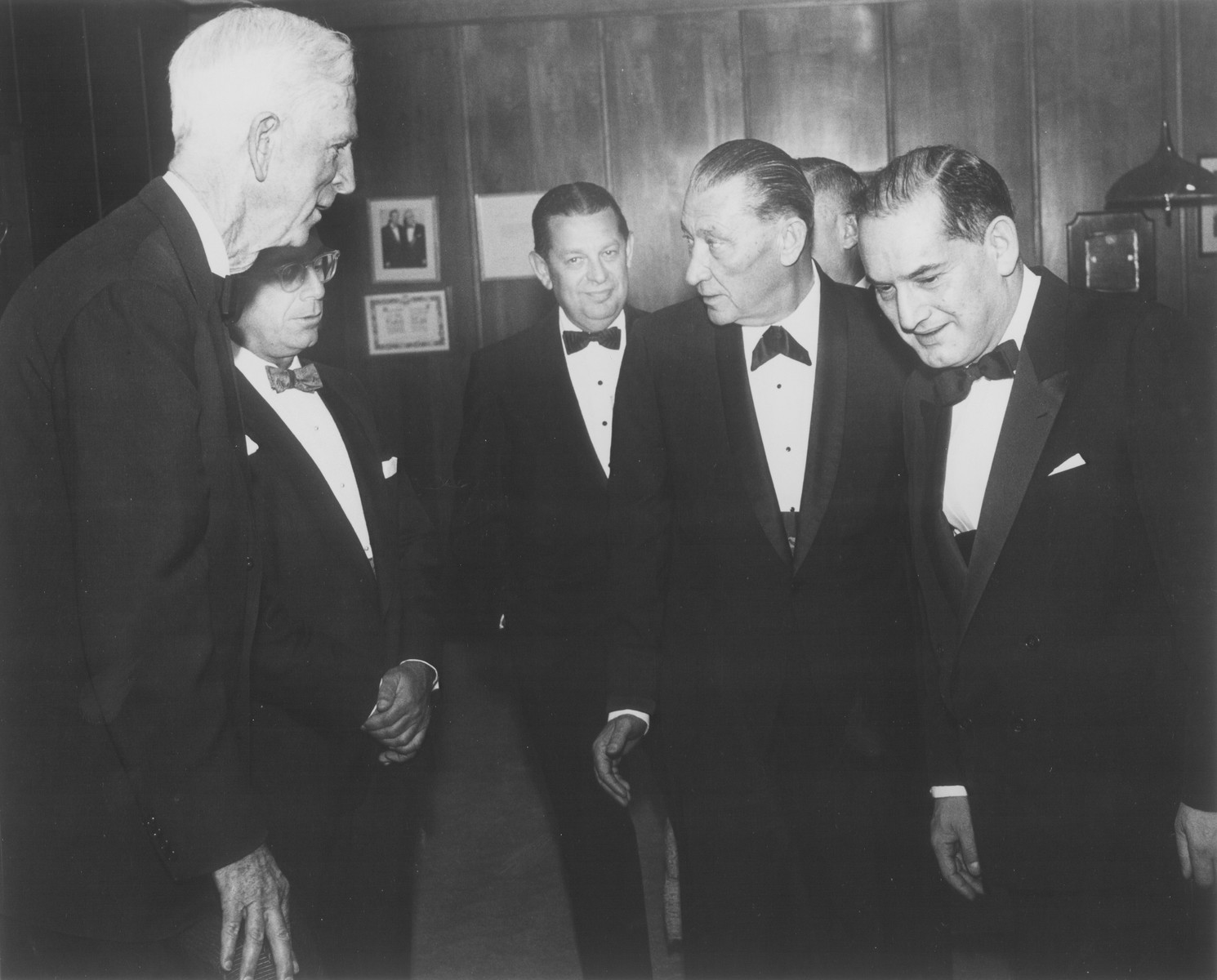 American Jewish philanthropist Abraham S. Kay speaks to James G. McDonald and others at an affair in Washington, D.C.  Pictured from left to right are: James G. McDonald, unknown, Stanley Weiner, Abraham S. Kay and Abraham Harman (right, foreground).