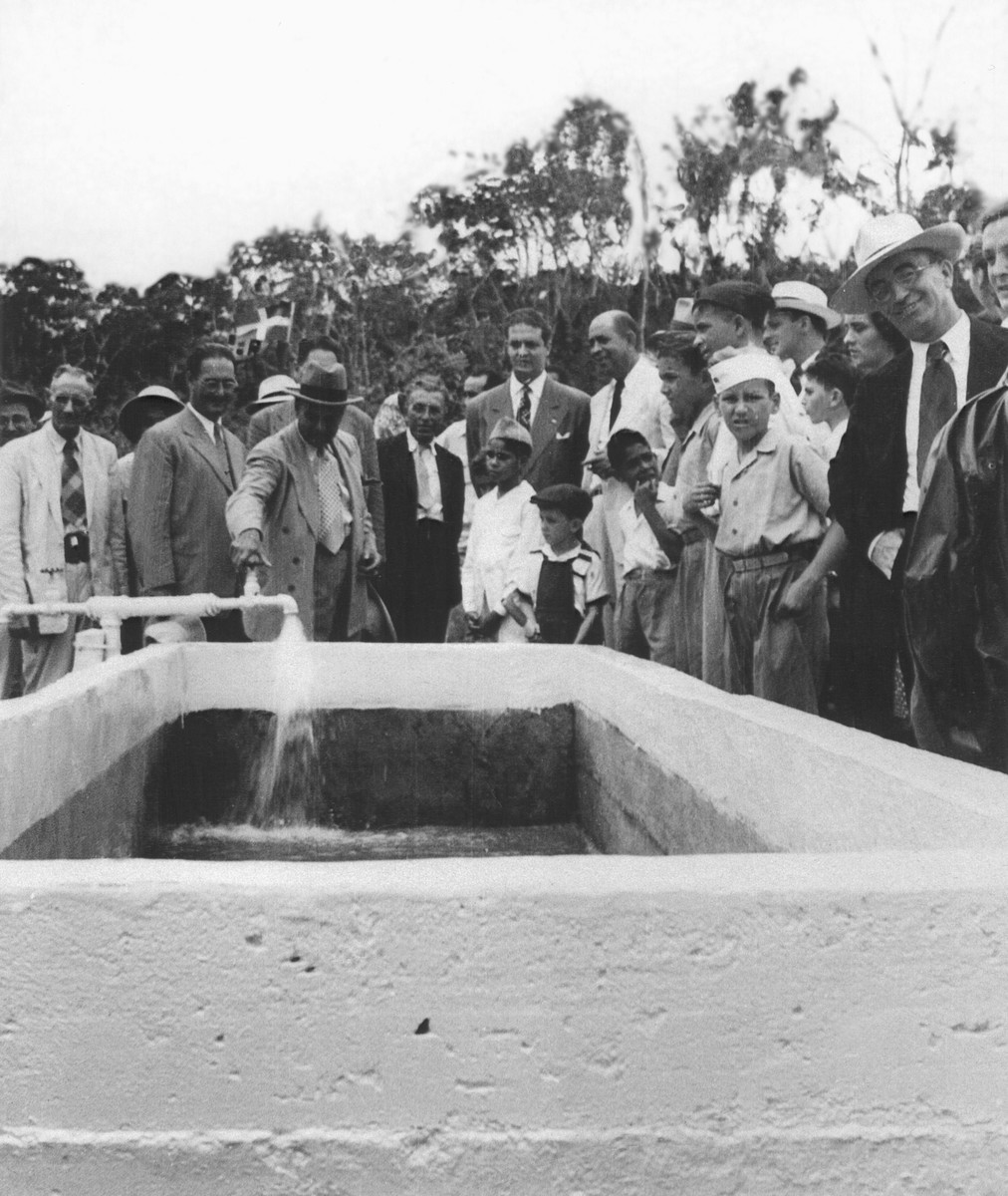 Jewish refugees and Dominicans attend the inauguration of the El Choco aqueduct in Sosua, which made possible the utilization of this mountainous region in Sosua for cattle raising.