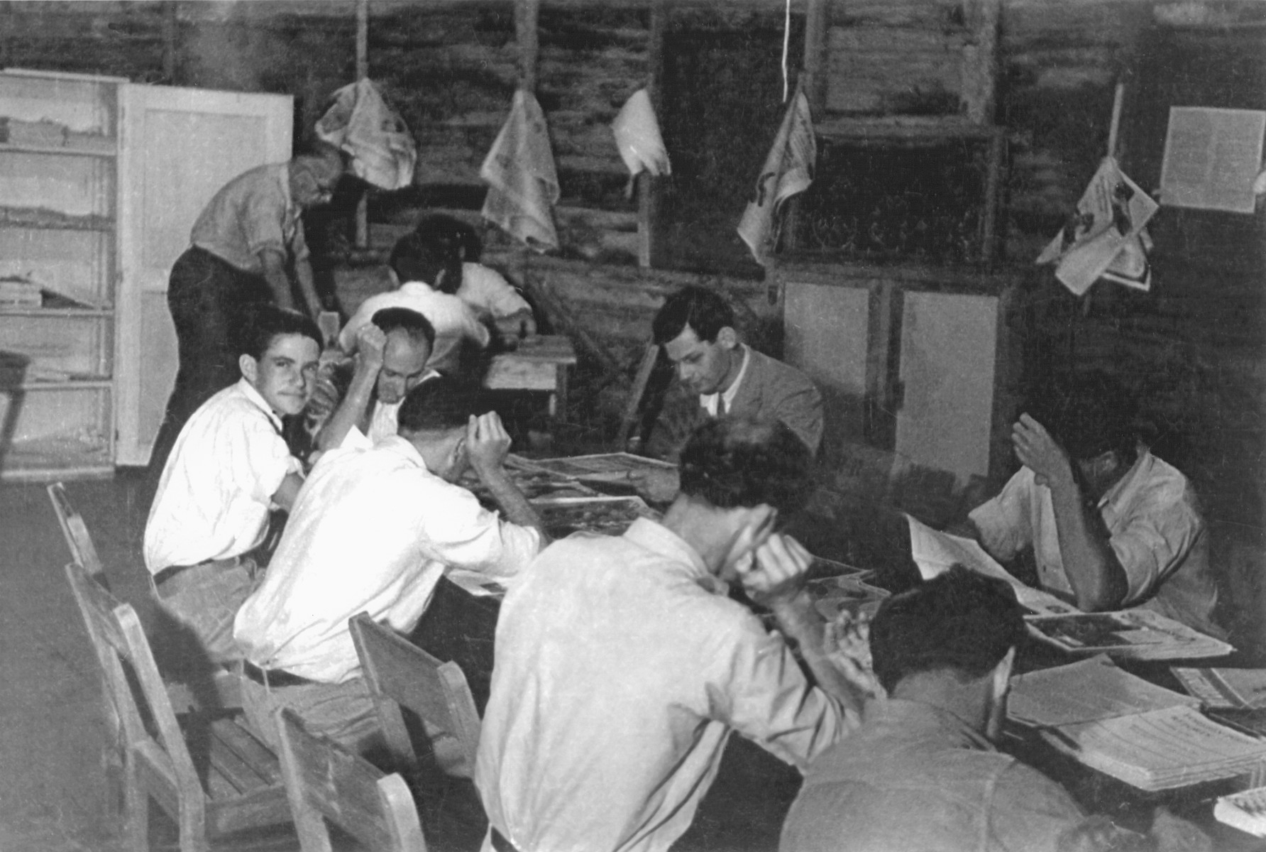 Jewish refugees read newspapers and magazines in the reading hall of the Sosua settlement.  Among those pictured is Kurt Wellisch (looking in direction of photographer).