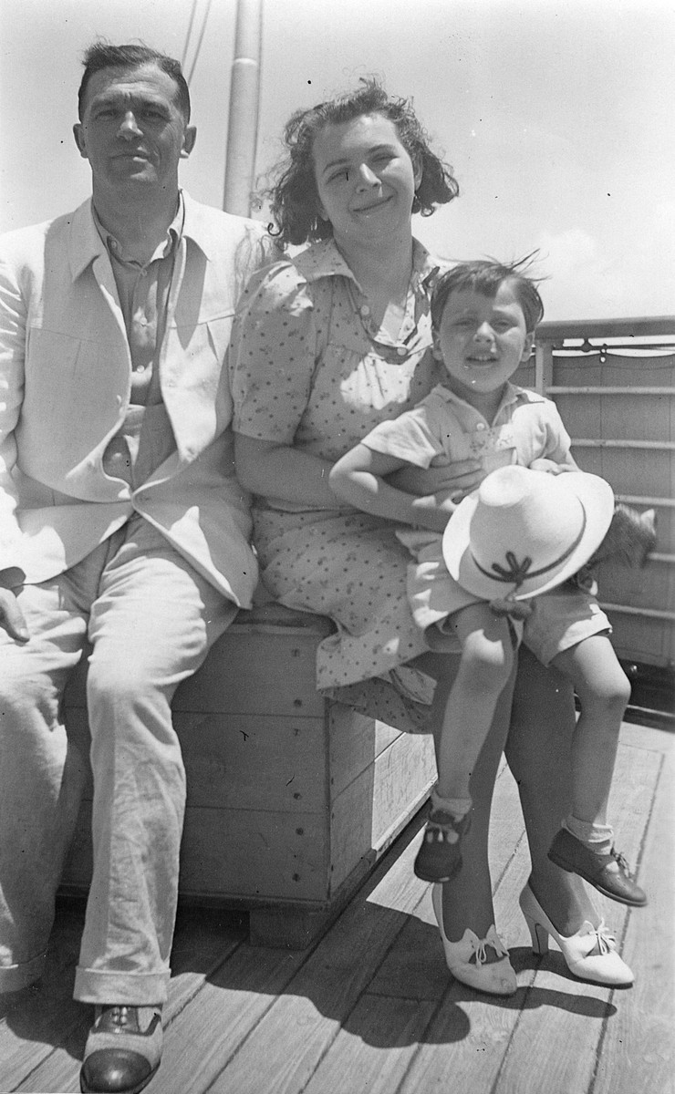 A German Jewish refugee family poses on the deck of the St. Louis while en route to Cuba.  Pictured on the right are Alice and Hans Meyerstein.  The man on the left is unidentified.