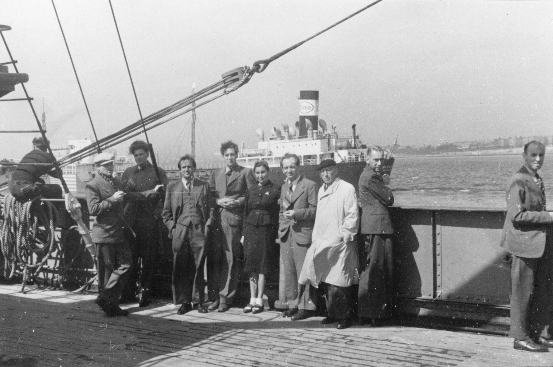 Group portrait of European refugees assisted by the Emergency Rescue Committee on board the  Capitaine Paul-Lemerle, a converted cargo ship sailing from Marseilles to Martinique.  Among those pictured are: Ernst Rossmann, Karl Heidenreich, Dyno Lowenstein, Katrin Kirschmann, Emil Kirschmann, and Peter Grassmann.