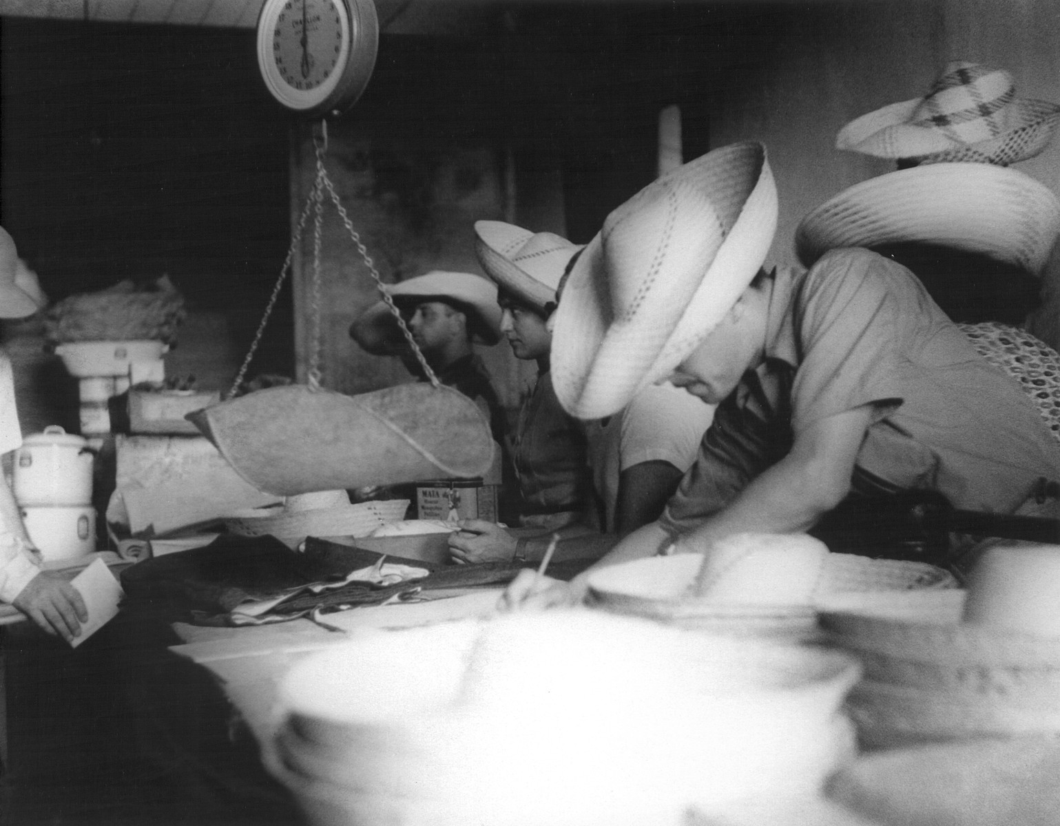 Jewish refugees make purchases in the El Colmado general store in Sosua.