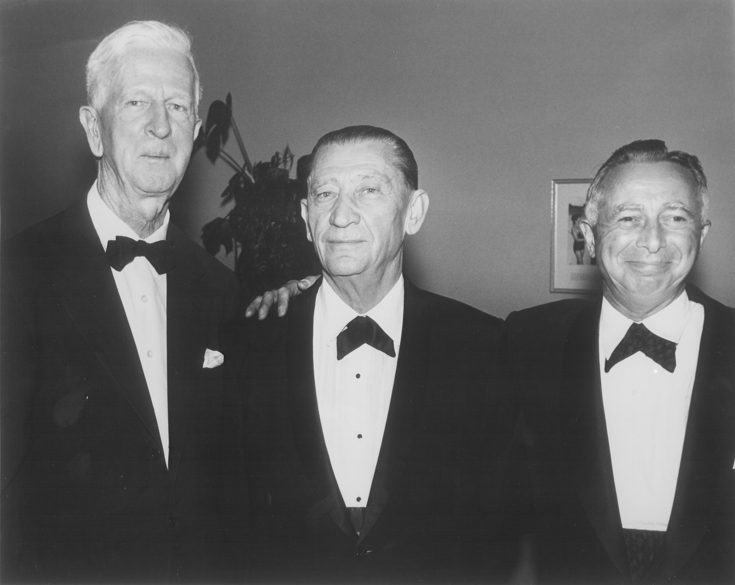 American Jewish philanthropist Abraham S. Kay (center) poses with James G. McDonald (left) and Samuel Sugar (right) at an affair in Washington, D.C.