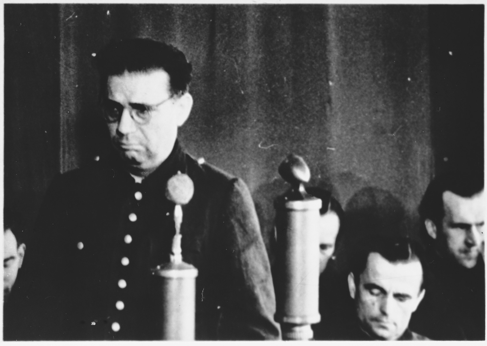 Defendant Kurt Eccarius speaks from the dock at the Sachsenhausen concentration camp war crimes trial in Berlin.