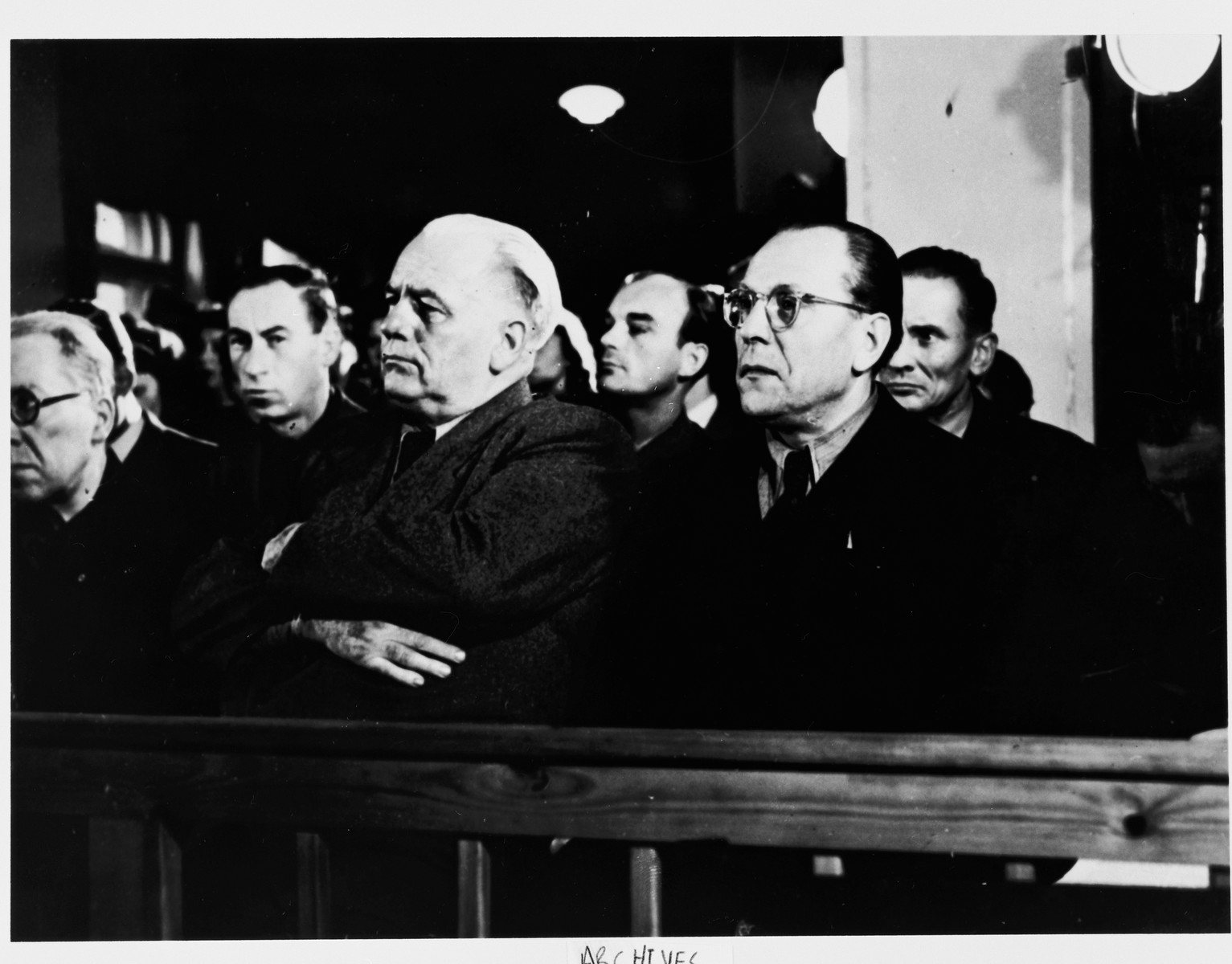 Spectators watch the proceedings at the Sachsenhausen concentration camp war crimes trial in Berlin.