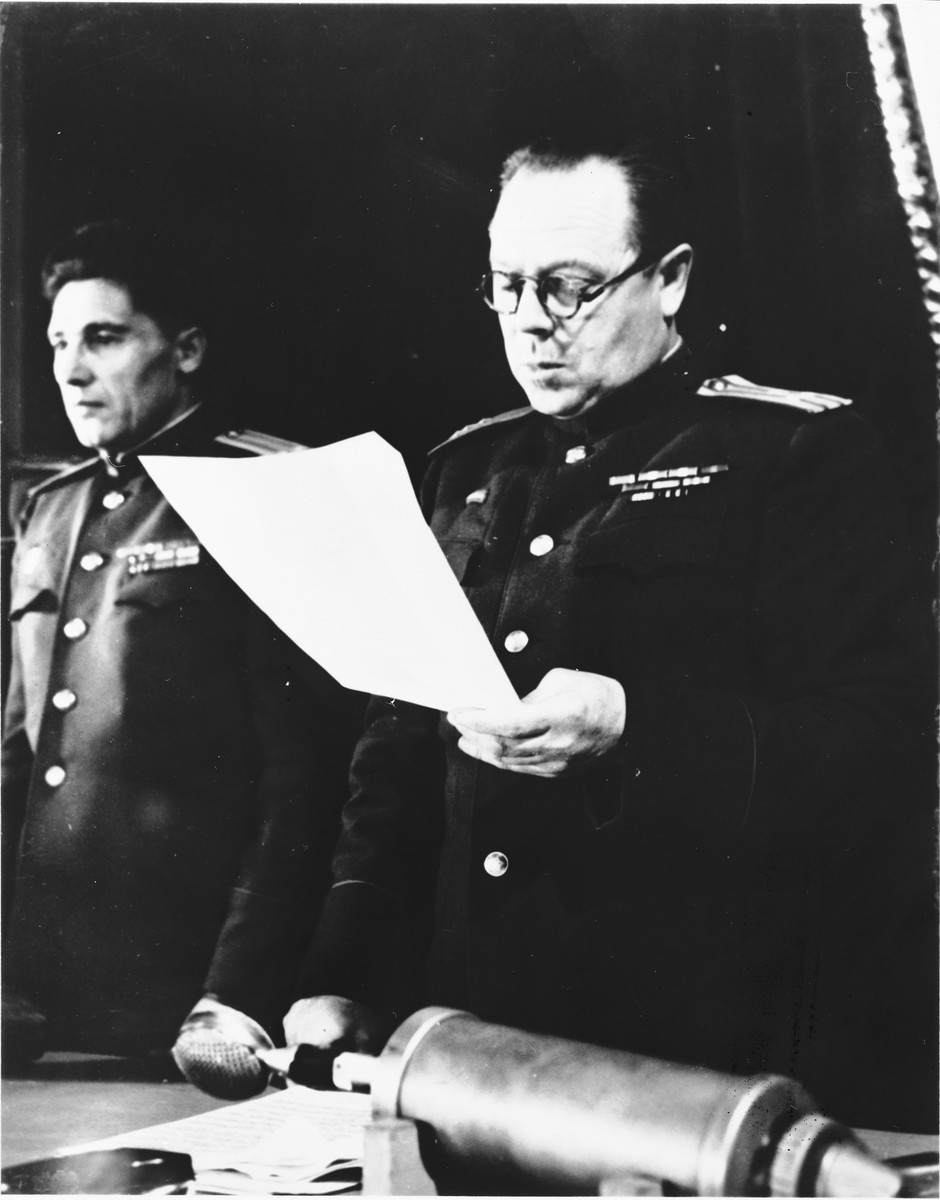The head of the Soviet Military Tribunal reads a statement at the Sachsenhausen concentration camp war crimes trial in Berlin.