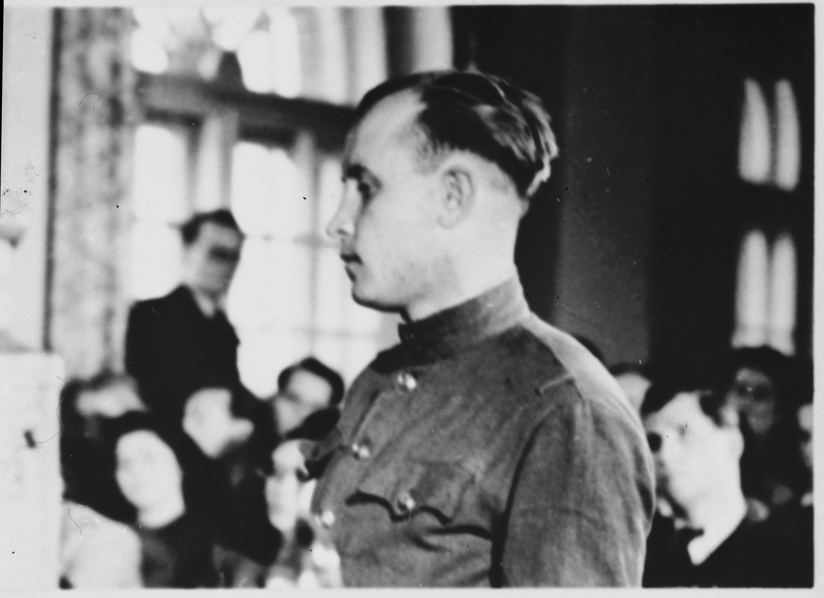 [A witness] testifies at the Sachsenhausen concentration camp war crimes trial in Berlin.