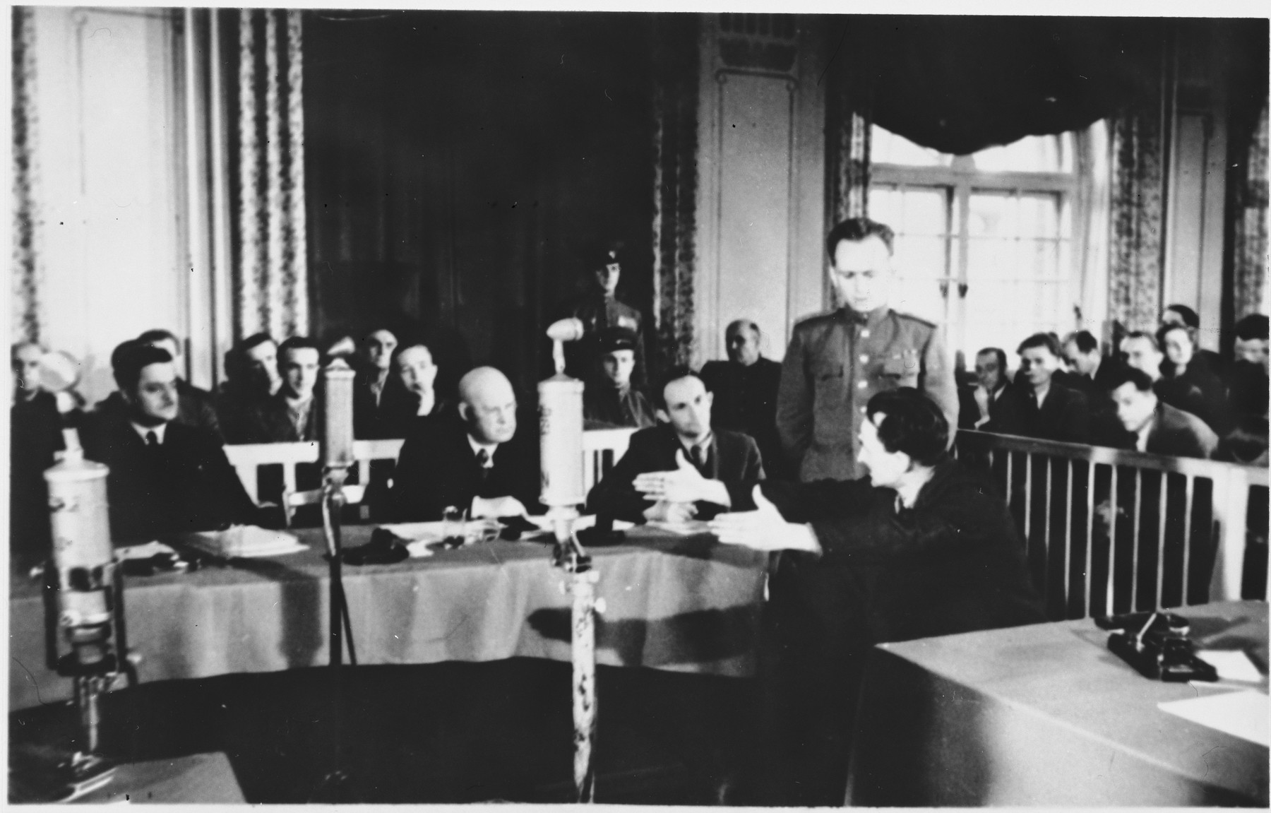 A witness testifies at the Sachsenhausen concentration camp war crimes trial in Berlin.
