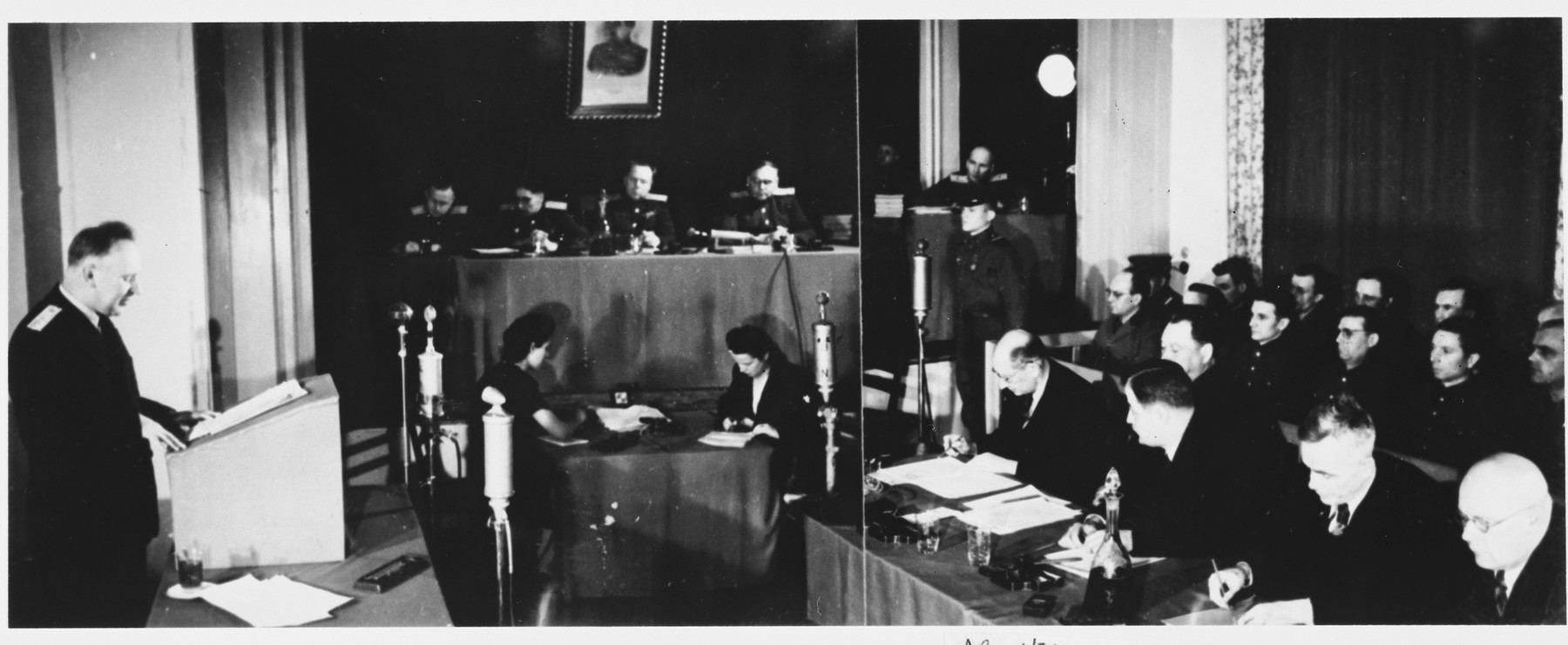 A member of the prosecution team (left) reads a statement at the Sachsenhausen concentration camp war crimes trial in Berlin.