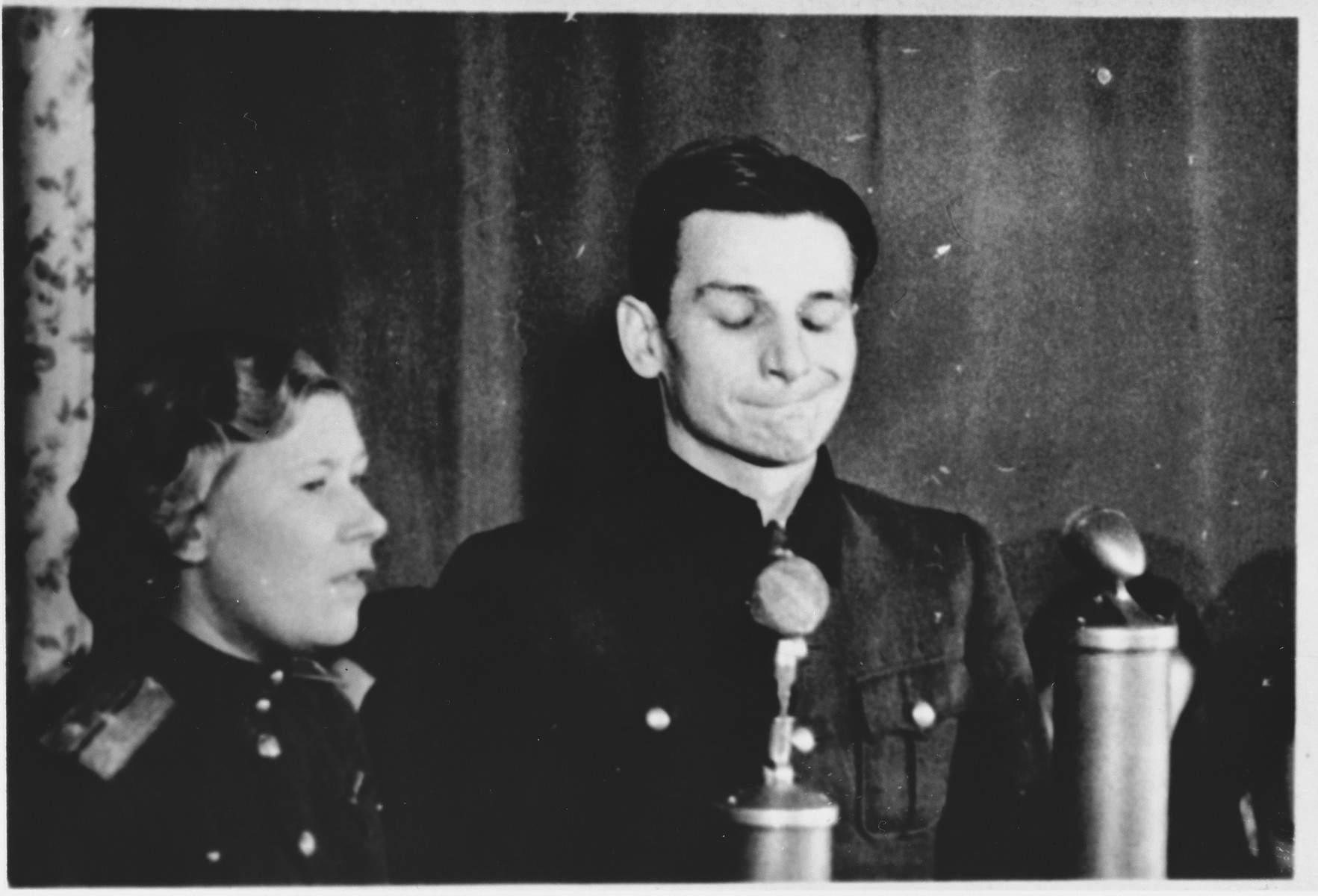 A defendant (probably Michael Koerner) speaks from the dock at the Sachsenhausen concentration camp war crimes trial in Berlin.
