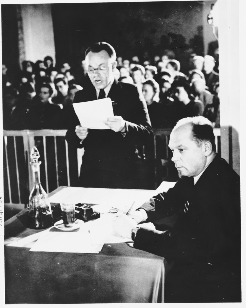 A member of the prosecution team reads a statement at the Sachsenhausen concentration camp war crimes trial in Berlin.