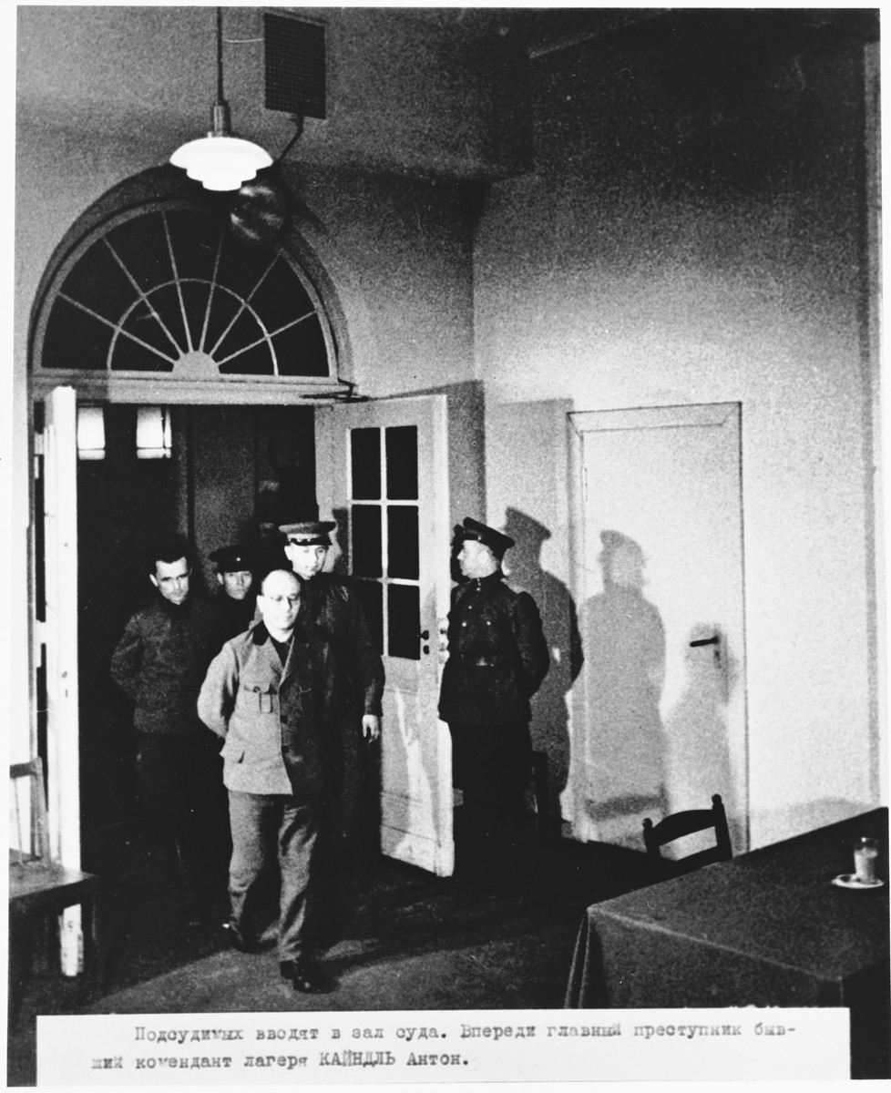 Defendants Anton Kaindl (front) and August Hoehn (left) are led into the courtroom at the Sachsenhausen concentration camp war crimes trial in Berlin.