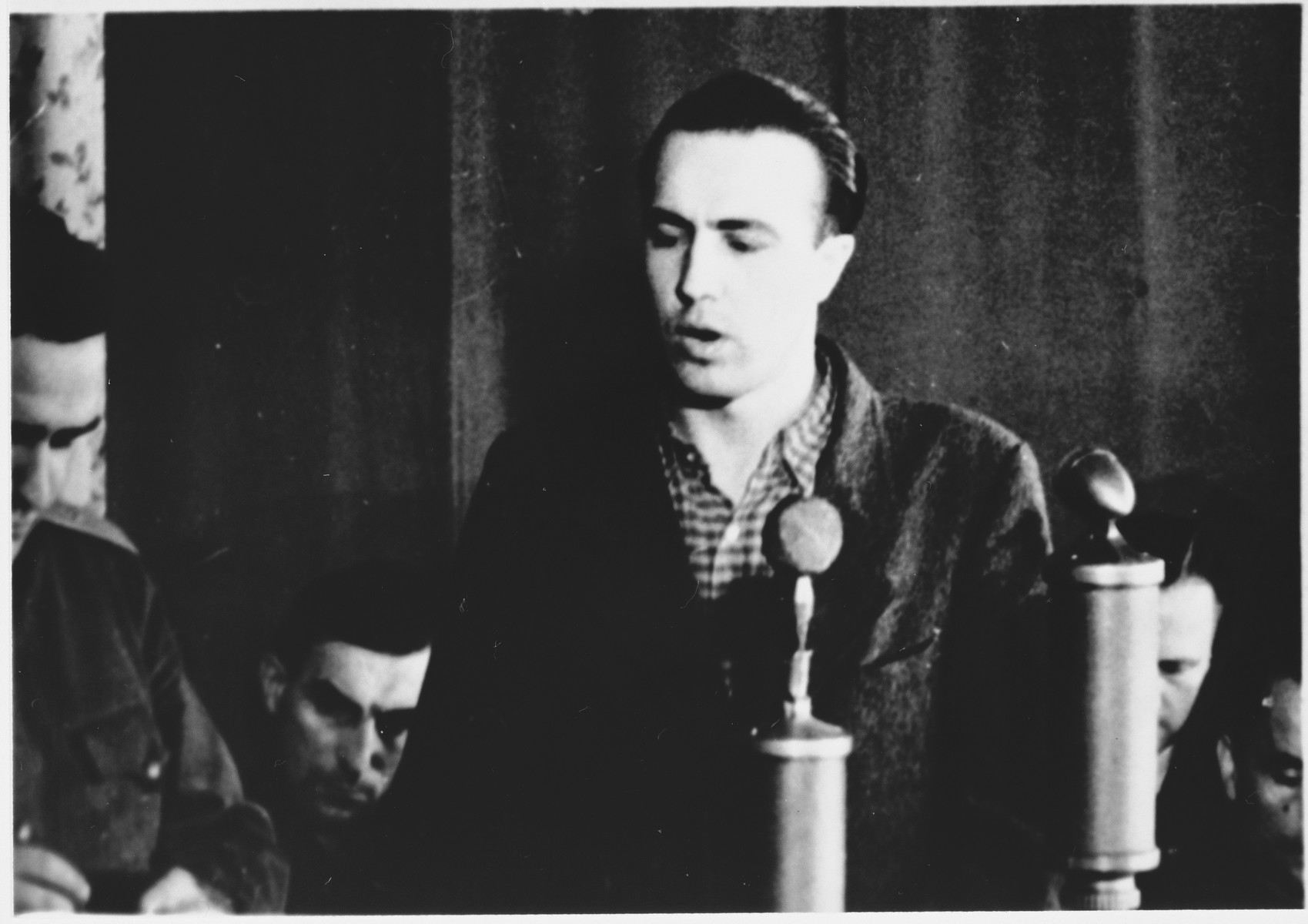 Defendant Ernst Brennscheidt speaks from the dock at the Sachsenhausen concentration camp war crimes trial in Berlin.