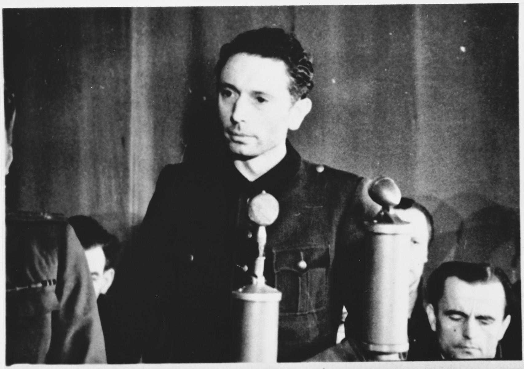 Defendant Heinz (Heinrich Friedrich) Baumkoetter speaks from the dock at the Sachsenhausen concentration camp war crimes trial in Berlin.