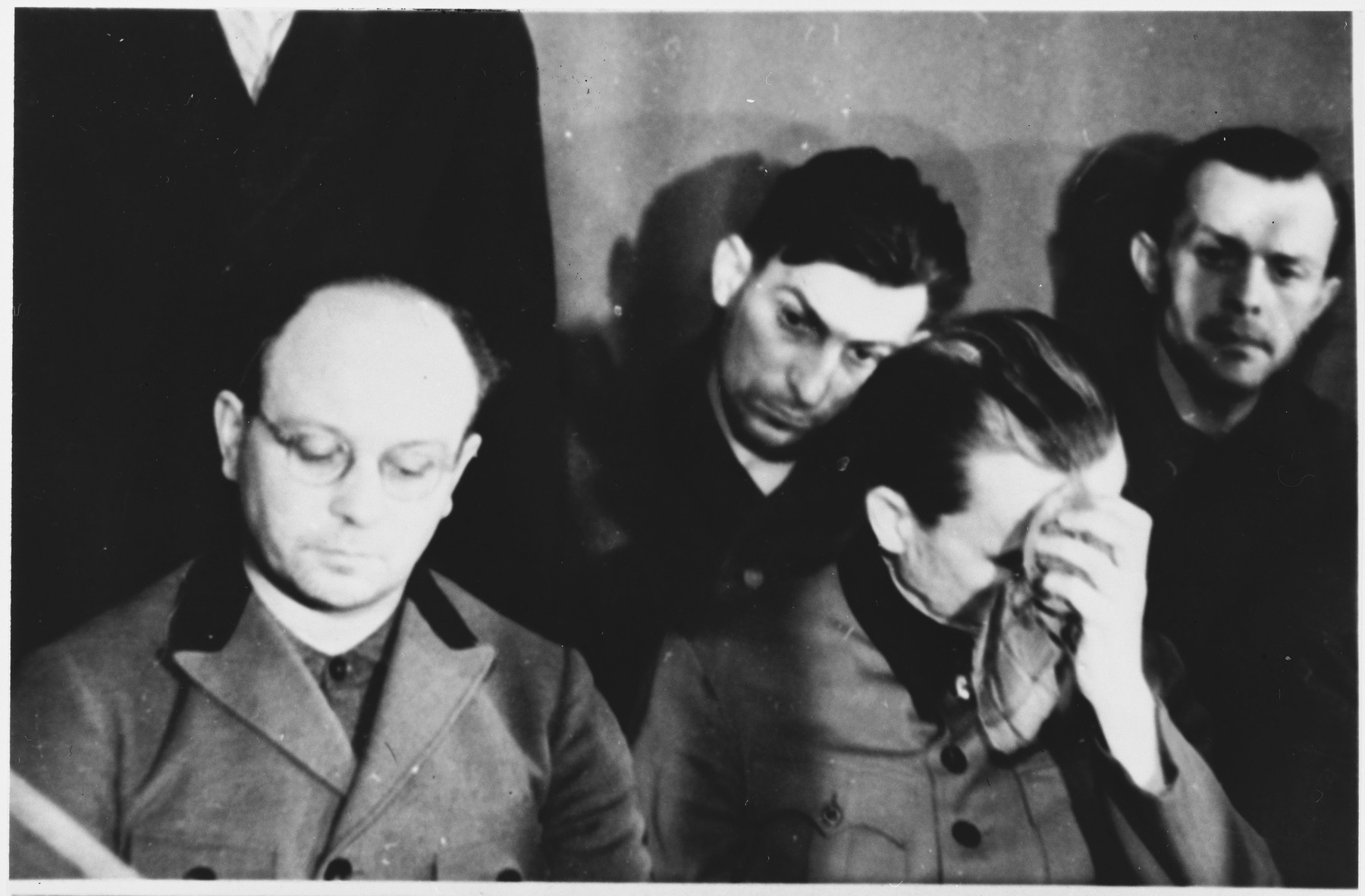 Defendants Anton Kaindl (left) and Gustav Sorge (back middle) at the Sachsenhausen concentration camp war crimes trial in Berlin.