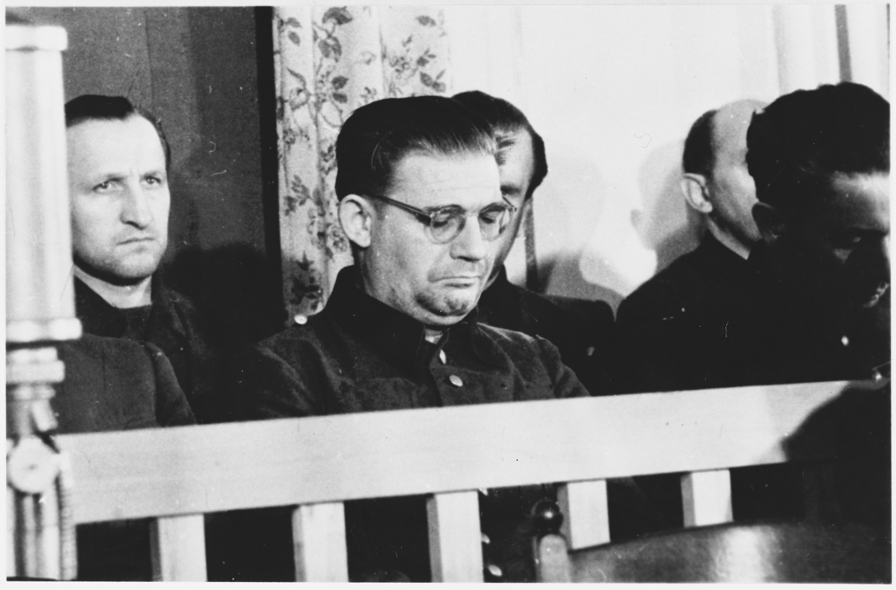 Defendants Martin Knittler (left) and Kurt Eccarius (center front) sit in the dock at the Sachsenhausen concentration camp war crimes trial in Berlin.