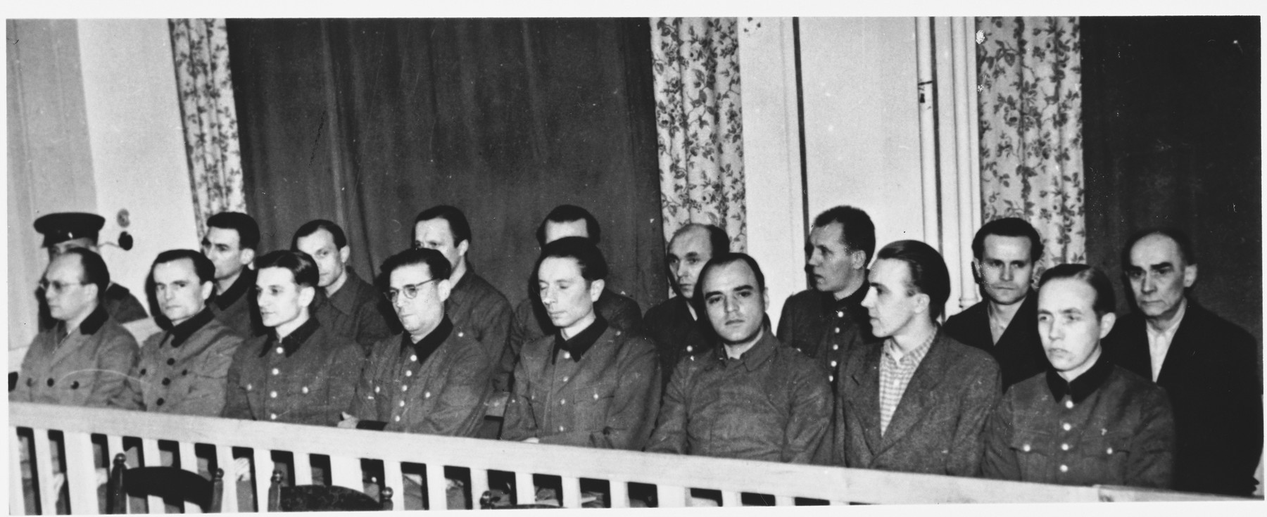 The defendants sit in the dock at the Sachsenhausen concentration camp war crimes trial in Berlin.