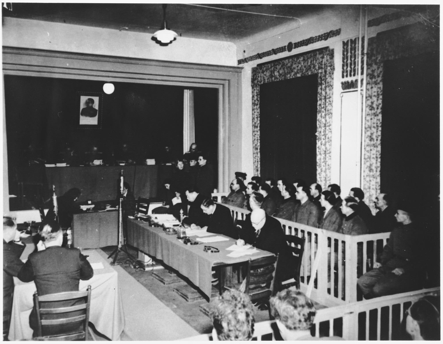 The defendants (right), their lawyers (center), and the Soviet Military Tribunal (back left) at the Sachsenhausen concentration camp war crimes trial in Berlin.