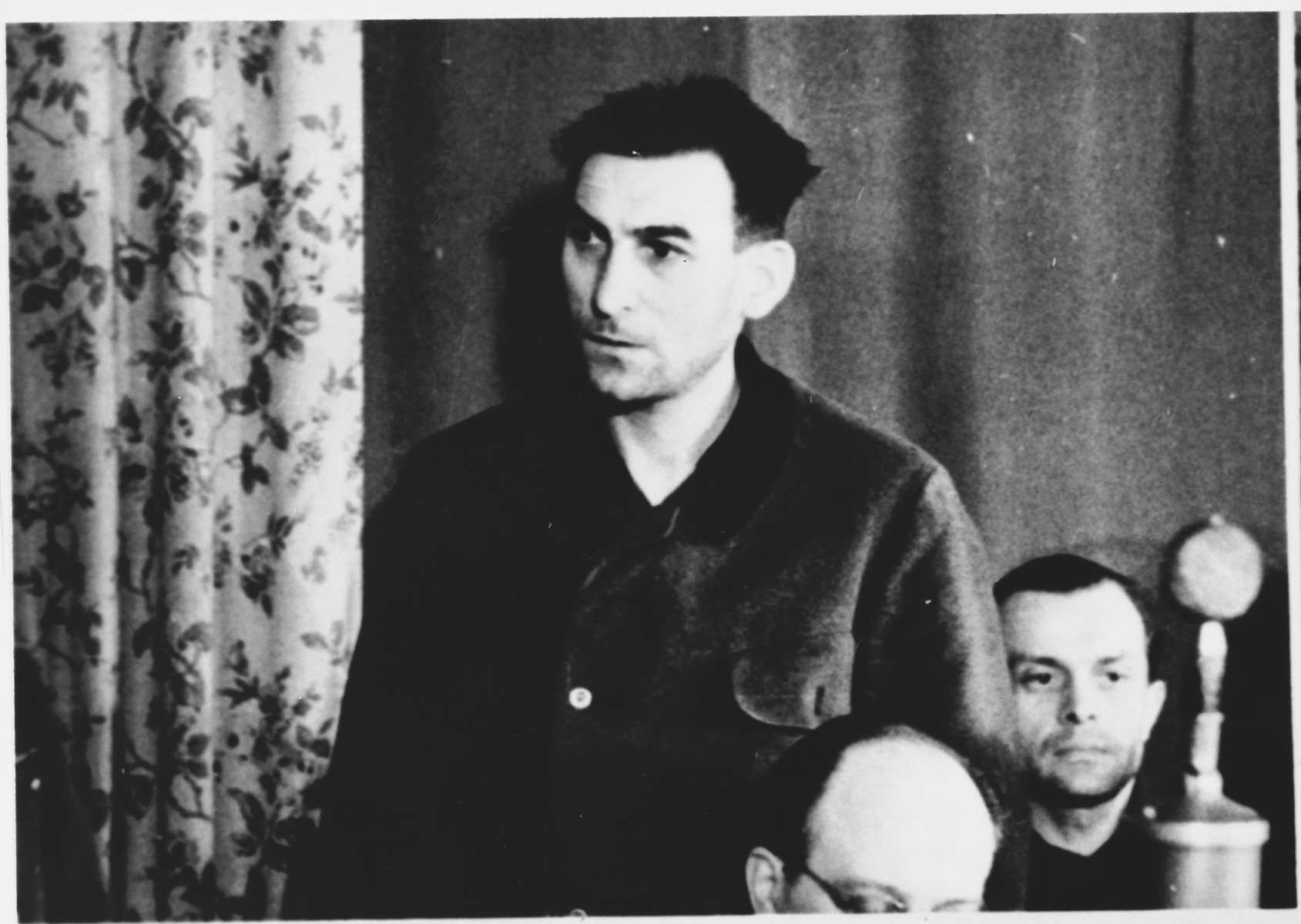 Defendant Gustav Sorge at the Sachsenhausen concentration camp war crimes trial in Berlin.   The man on the right has been identified as Wilhelm Schubert.