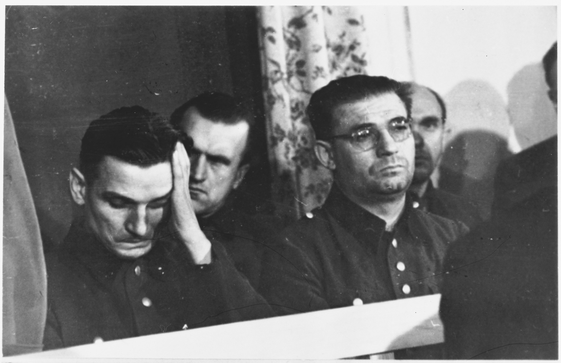 Defendants Michael Koerner (left) and Kurt Eccarius (right) sit in the dock at the Sachsenhausen concentration camp war crimes trial in Berlin.