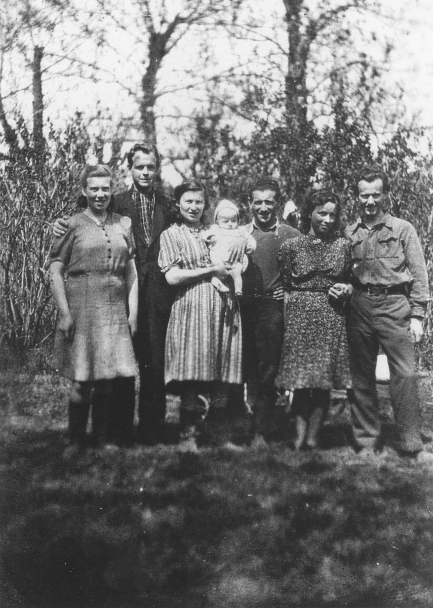 Selma and Chaim Engel (center) pose with their child and two other couples in Odessa where they were living under the assumed name of Kriseck.