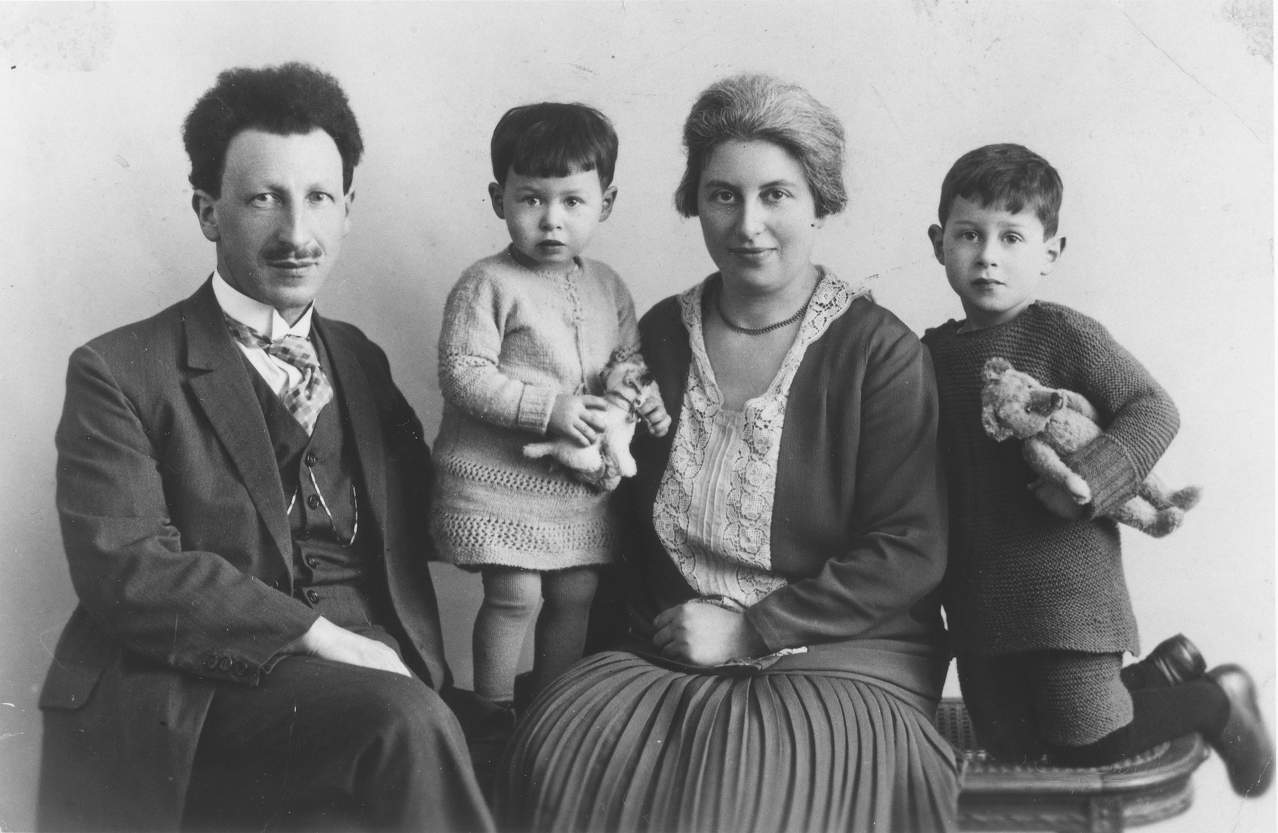 Studio portrait of the Wijnberg family from Groningen, Holland.  Pictured from left to right are, Jonas, Henny, Mietje and Bram Wijnberg.  Jonas Wijnberg, the uncle of Selma Wijnberg, was a schoolteacher in Groningen.  His entire family perished during the war.