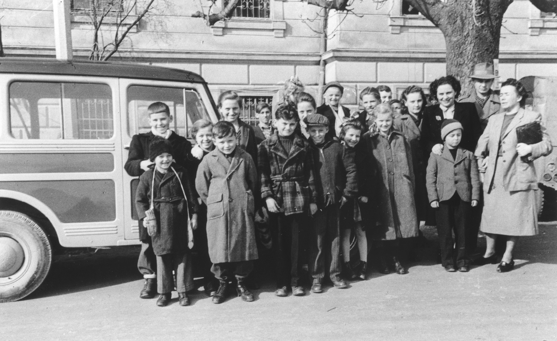 DP children from the Bad Schallerbach children's home pose with members of the staff before their departure for the United States.